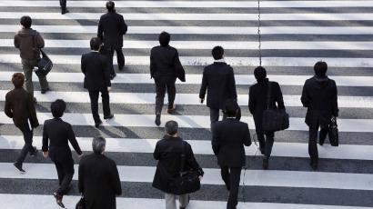 businesspeople crossing a street