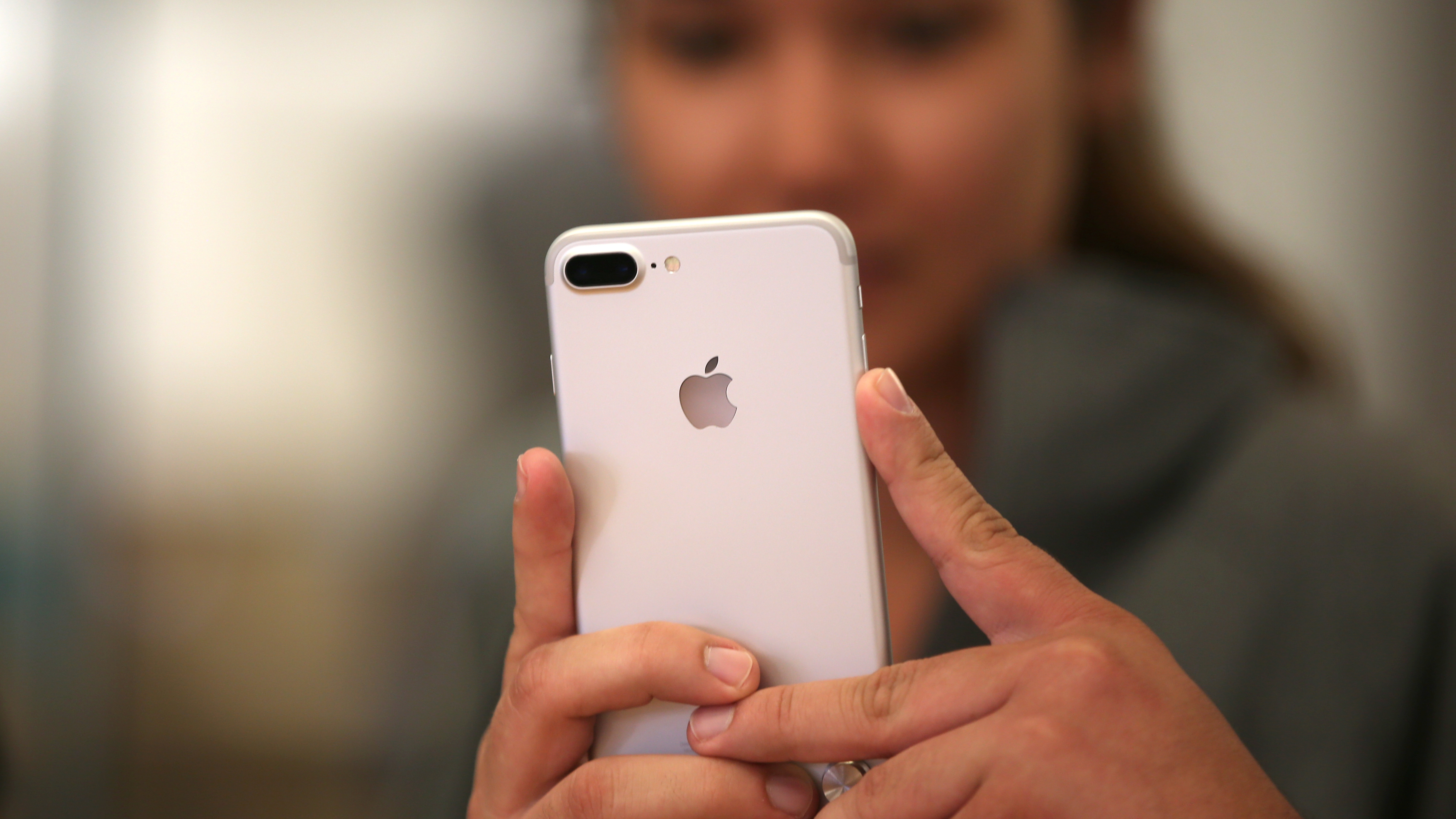 A customer views the new iPhone 7 smartphone inside an Apple Inc. store in Los Angeles