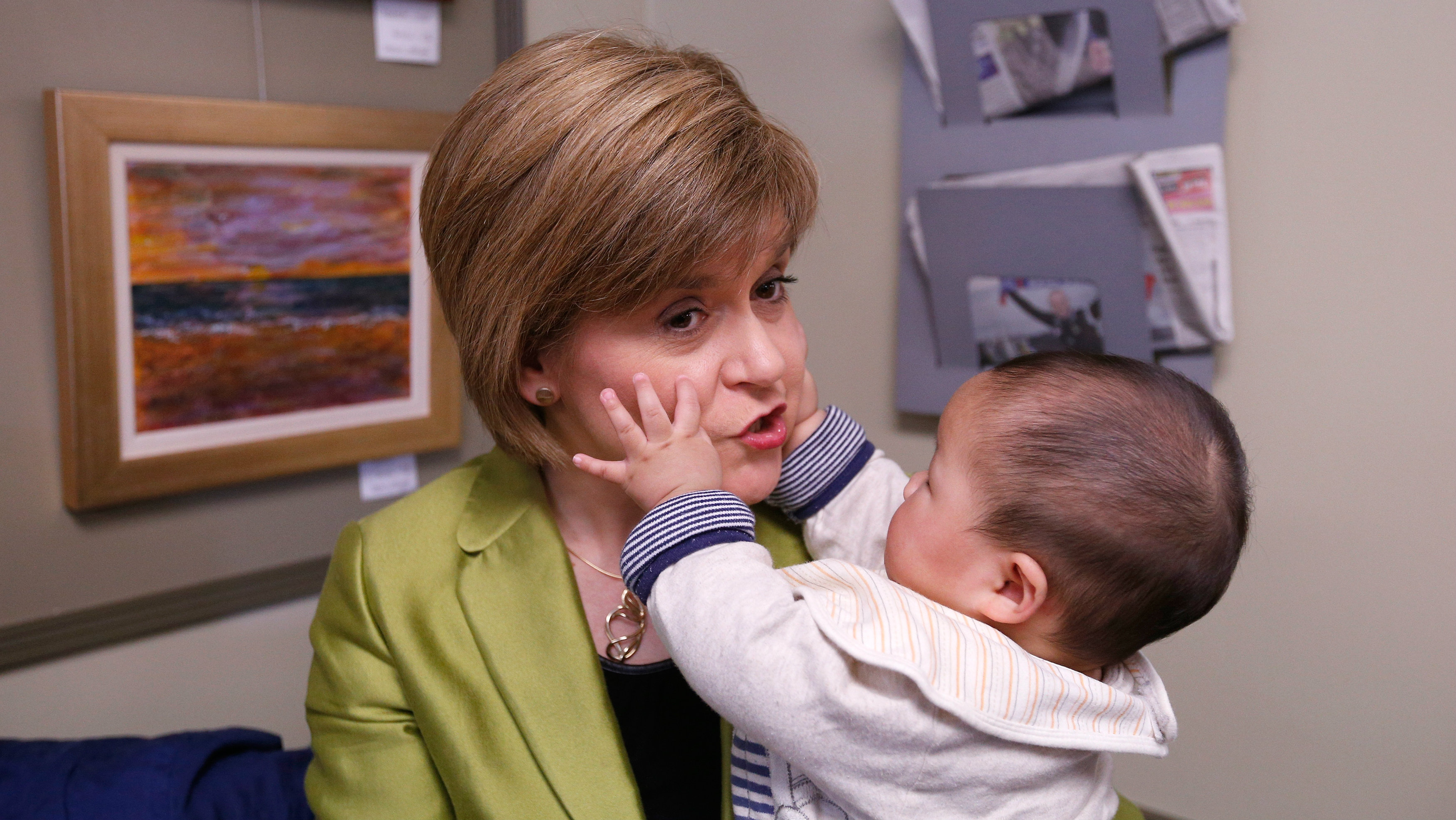 The leader of the Scottish National Party (SNP) Nicola Sturgeon holds a baby during campaigning in Inverurie, Aberdeenshire, April 18, 2015. REUTERS/Russell Cheyne TPX IMAGES OF THE DAY