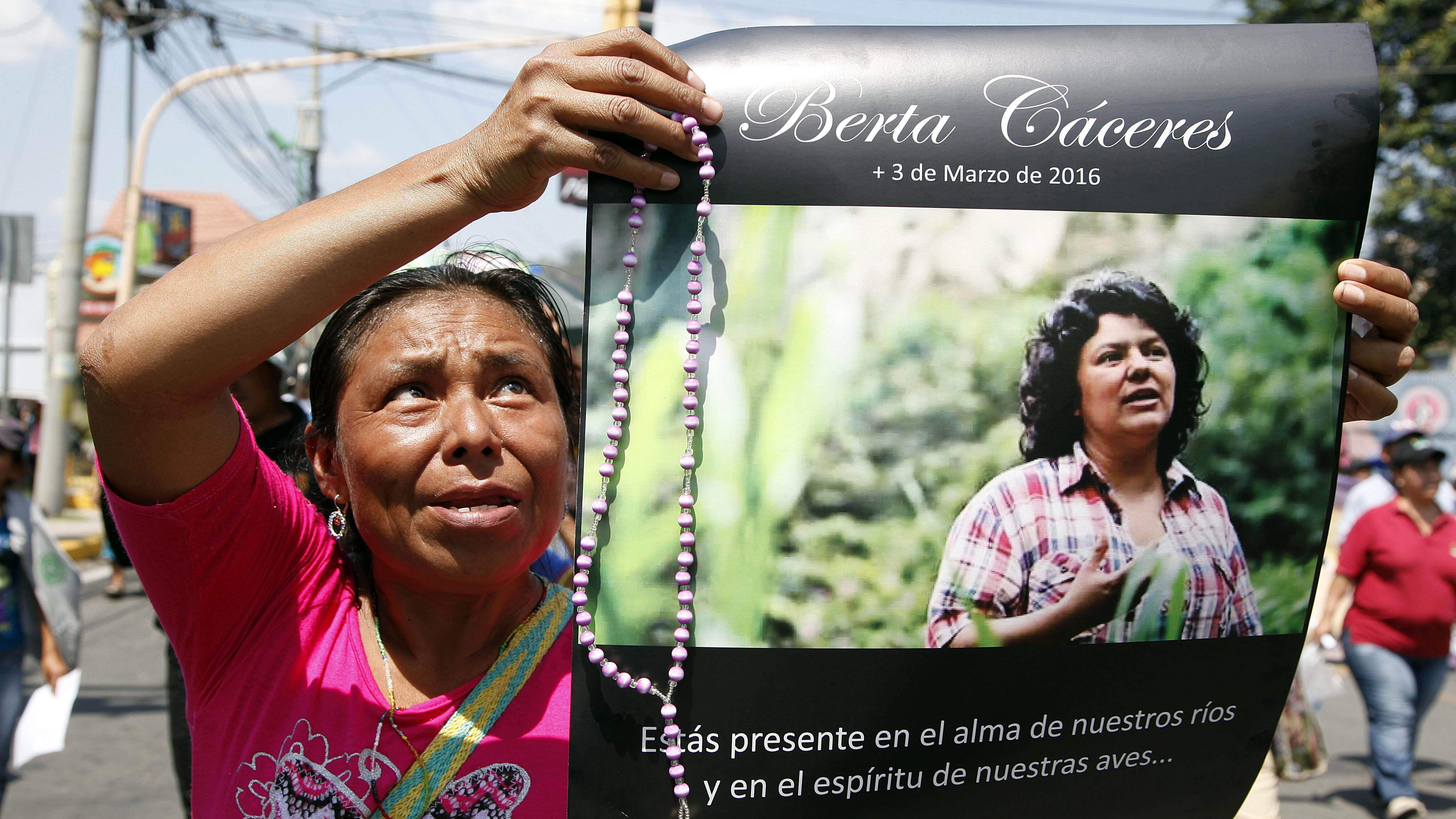 A woman holds up a poster with a photo of slain environmental leader Berta Caceres during a protest in Tegucigalpa, Honduras. Caceres reported receiving threats from DESA security personnel, as well as an attempt by a company official to bribe her to call off the demonstrations, according to Billy Kyte, a senior campaigner on land and environmental defense at London-based Global Witness. DESA, or Desarrollos Energeticos SA, is the company carrying out the Agua Zarca hydroelectric project that Caceres lead protests against.