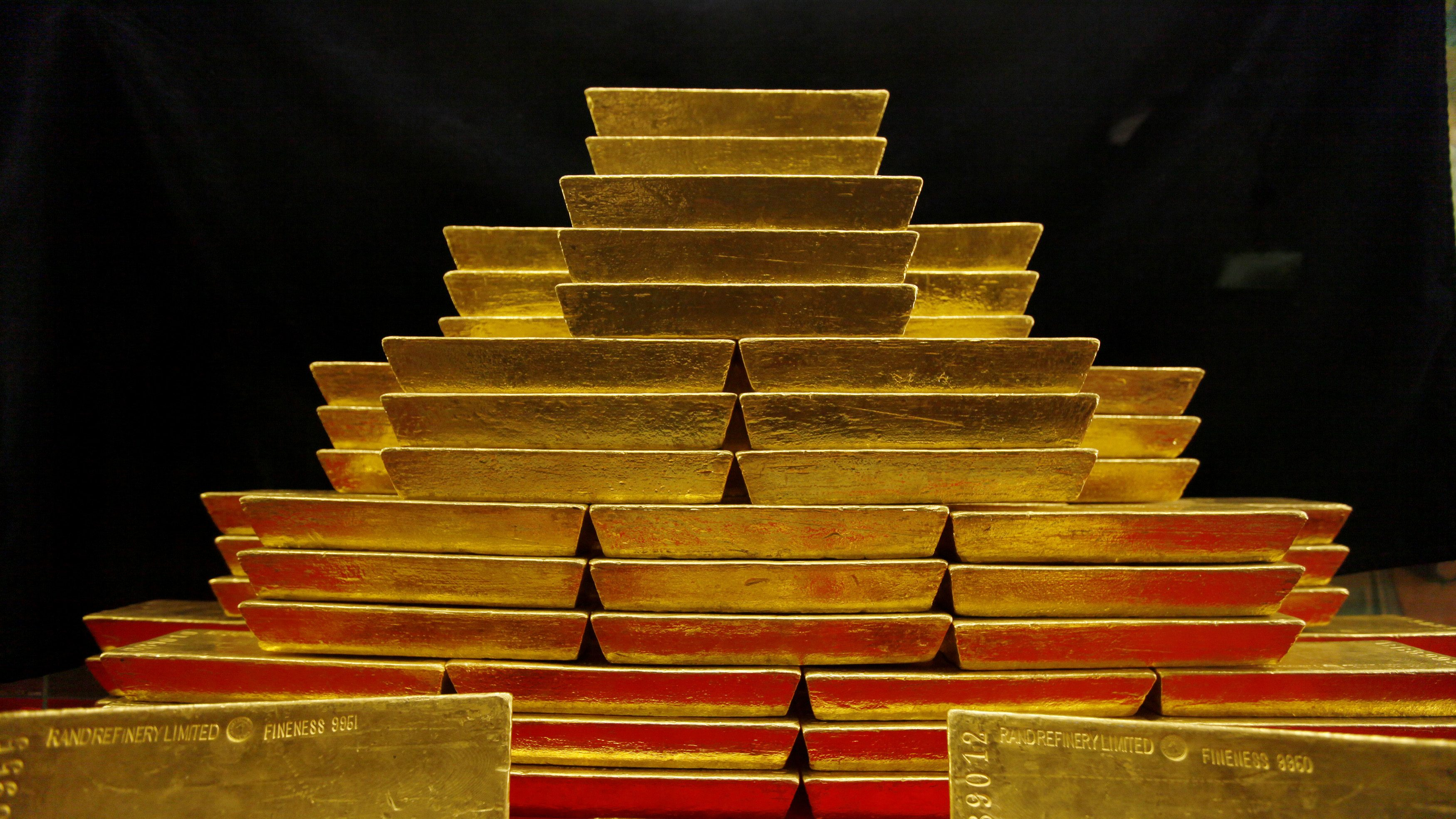 A pile of gold bars is seen in this picture illustration taken at the Czech National Bank in Prague January 31, 2011.