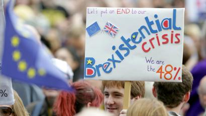 A man holds a banner during a demonstration against Britain's decision to leave the European Union, in central London, Britain July 2, 2016. Britain voted to leave the European Union in the EU Brexit referendum.