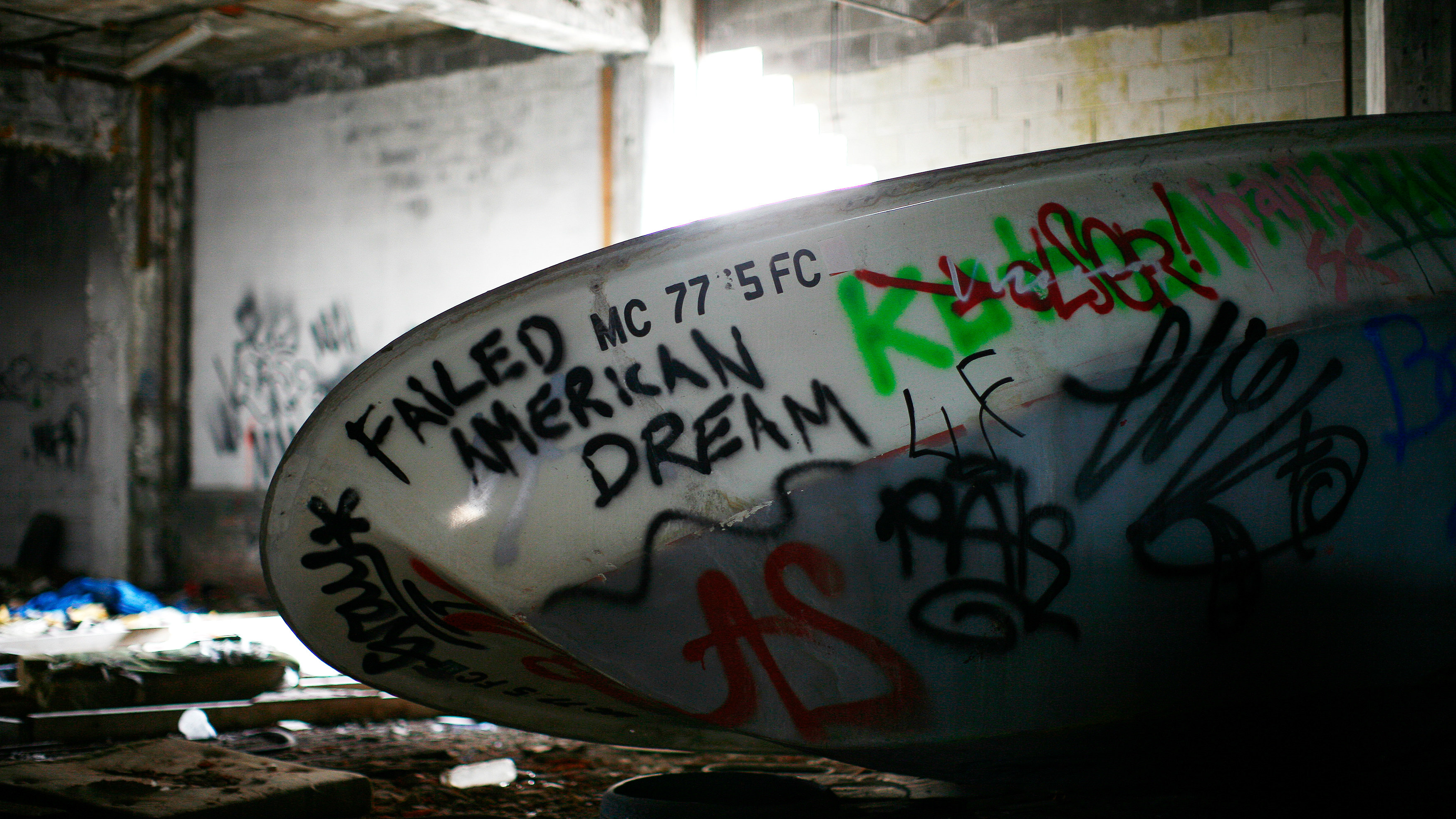 A boat filled with graffiti is seen inside the abandoned and decaying manufacturing plant of Packard Motor Car in Detroit