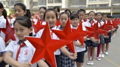 Students pose with red stars during an event to mark the 70th anniversary of the Victory of Chinese People's War of Resistance Against Japanese Aggression and the World Anti-Fascist War, at a primary school in Handan, Hebei province, China, August 31, 2015. China will mark the 70th anniversary of the end of World War Two with a massive military parade this Thursday, with some 12,000 soldiers marching through Beijing's central Tiananmen Square. REUTERS/China Daily CHINA OUT. NO COMMERCIAL OR EDITORIAL SALES IN CHINA. - RTX1QCK3