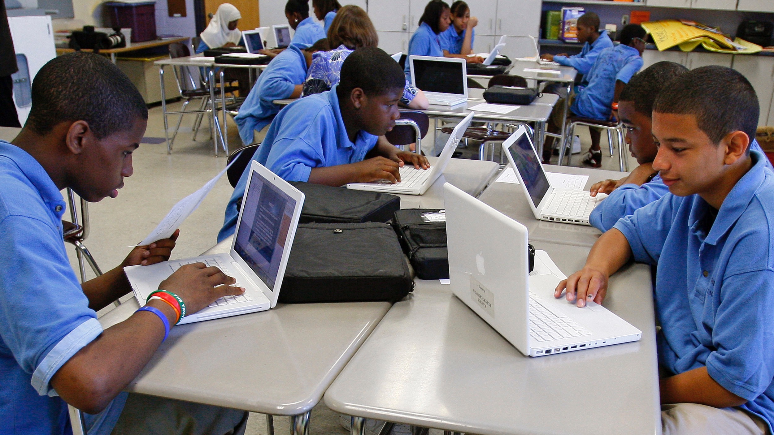children in classroom with computers