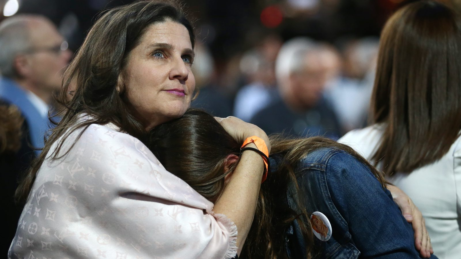 A Hillary Clinton supporter is comforted.