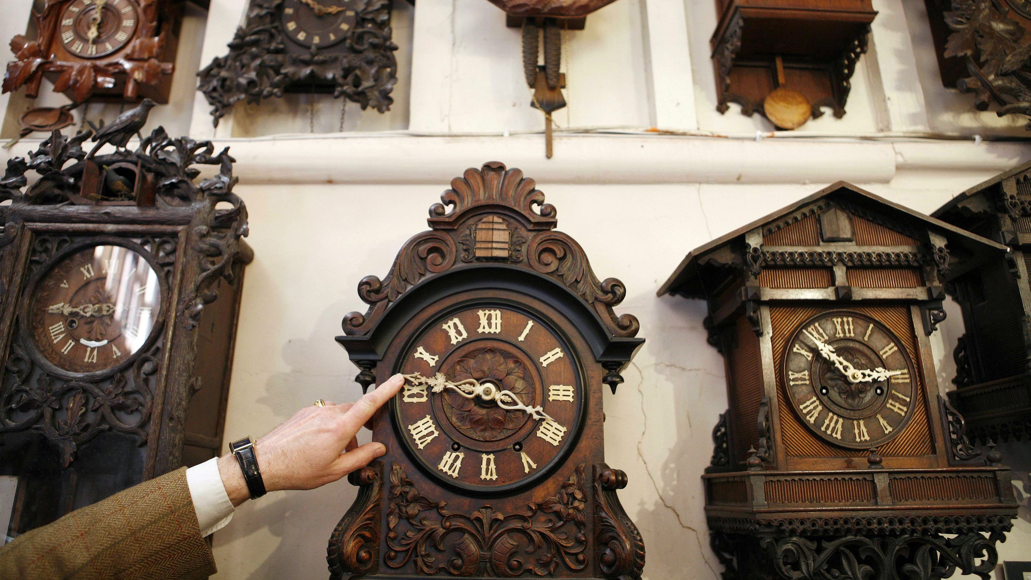 Adjusting the time on a cuckoo clock.