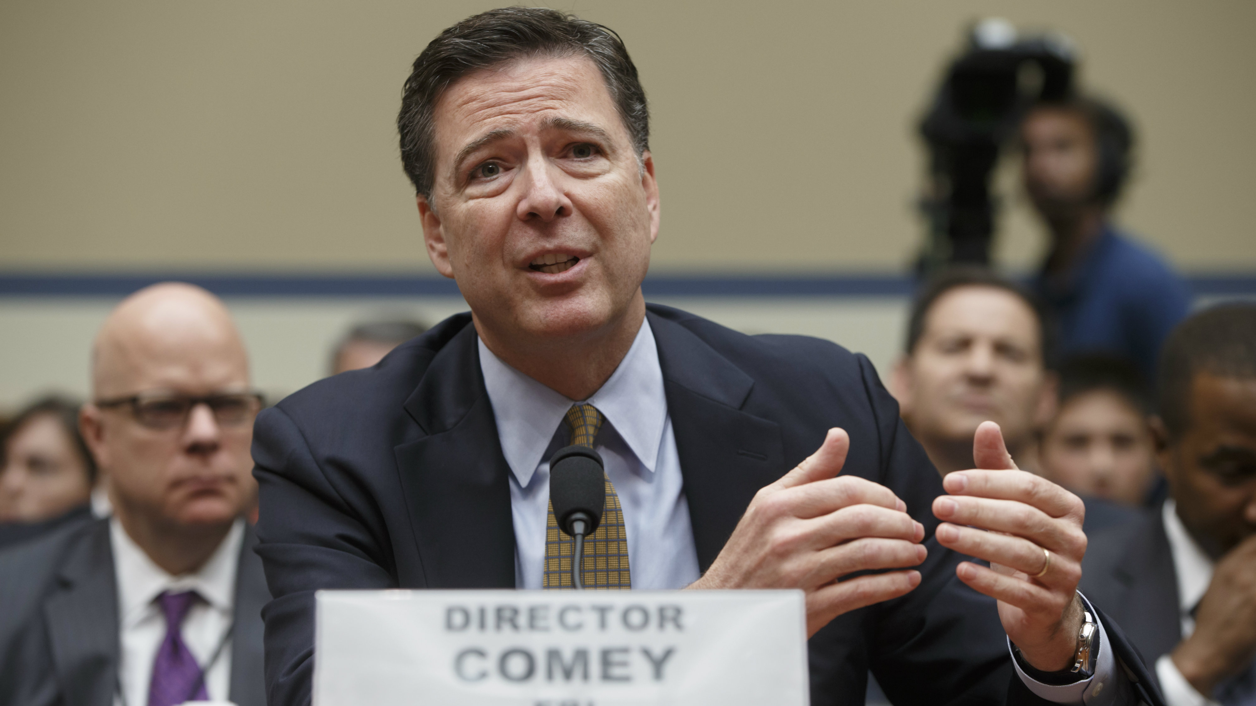 FBI Director James Comey testifies on Capitol Hill in Washington before the House Oversight Committee to explain his agency's recommendation to not prosecute Hillary Clinton. In a letter from Comey released on Nov. 6, he tells Congress review of additional Clinton emails does not change conclusion she should not face charges.
