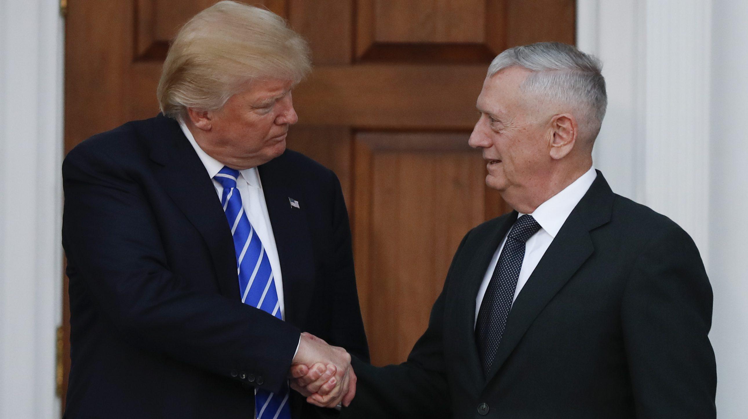 President-elect Donald Trump shakes hands with retired Marine Corps Gen. James Mattis