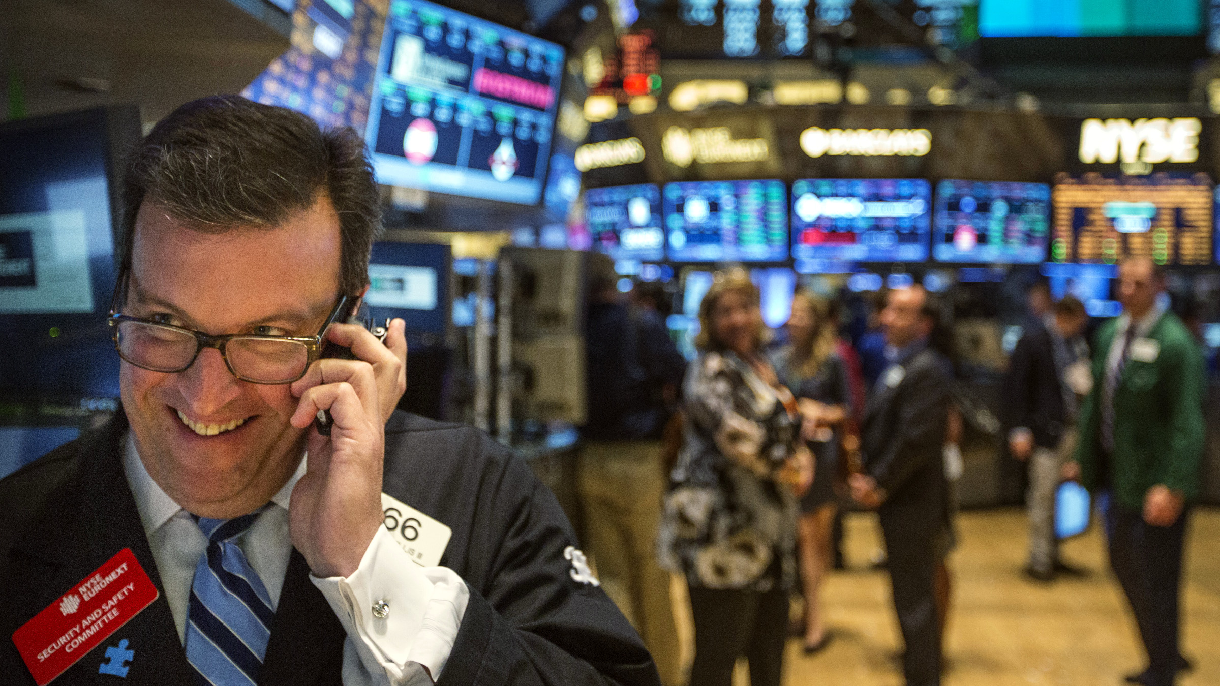 A trader works on the floor of the New York Stock Exchange shortly before the end of the day's trading in New York July 31, 2013.