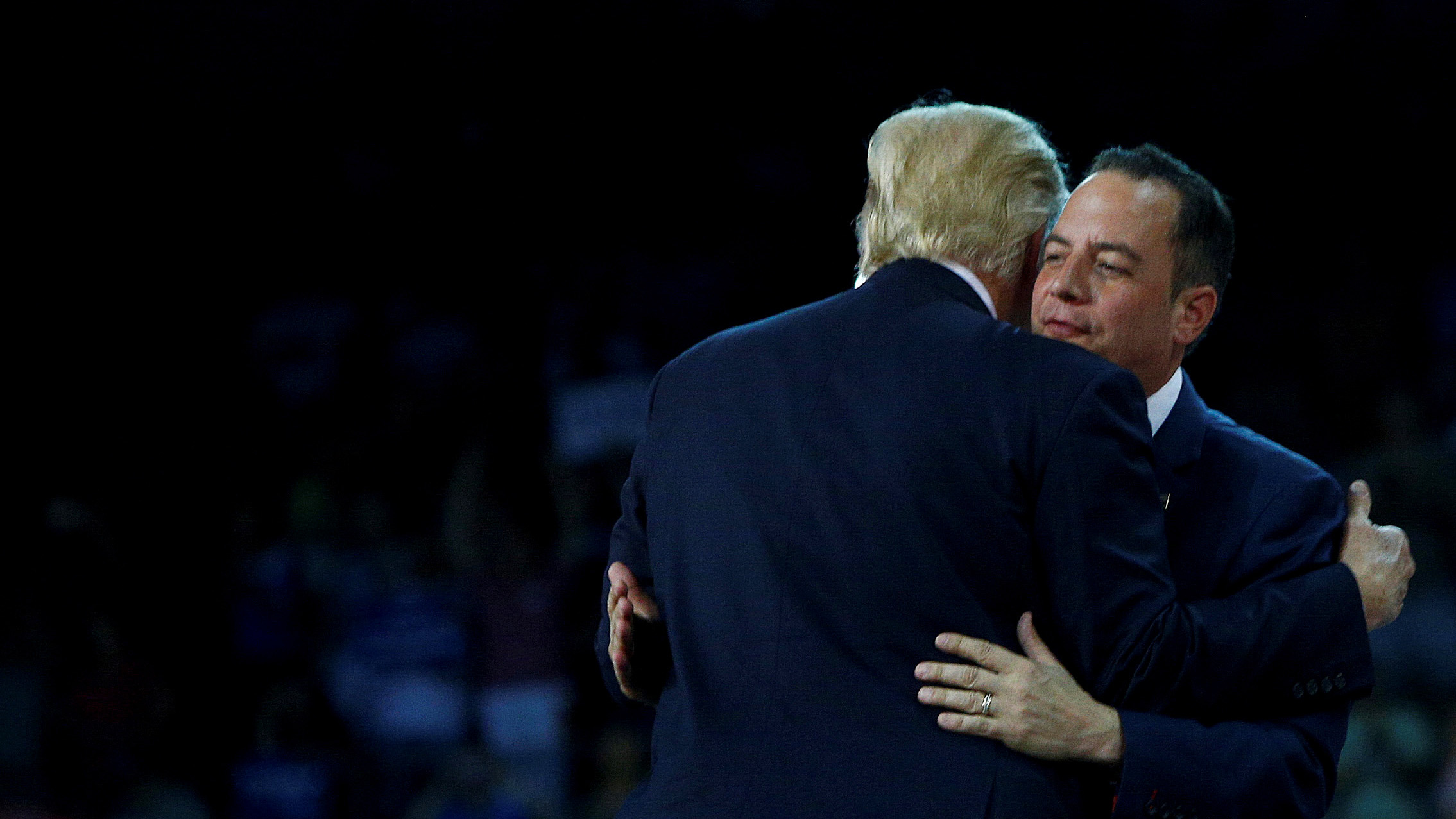 Republican U.S. presidential nominee Donald Trump greets Republican National Committee chairman Reince Priebus during a campaign rally at the Erie Insurance Arena in Erie, Pennsylvania August 12, 2016. REUTERS/Eric Thayer - RTSN11M
