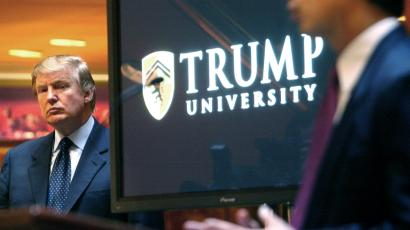 "In this May 23, 2005 file photo, real estate mogul and Reality TV star Donald Trump, left, listens as Michael Sexton introduces him at a news conference in New York where he announced the establishment of Trump University. New York Attorney General Eric Schneiderman is suing Trump for $40 million, saying that ""Trump University"" didn't deliver on its advertised promise to make students rich, but instead steered them into expensive yet mostly useless seminars."
