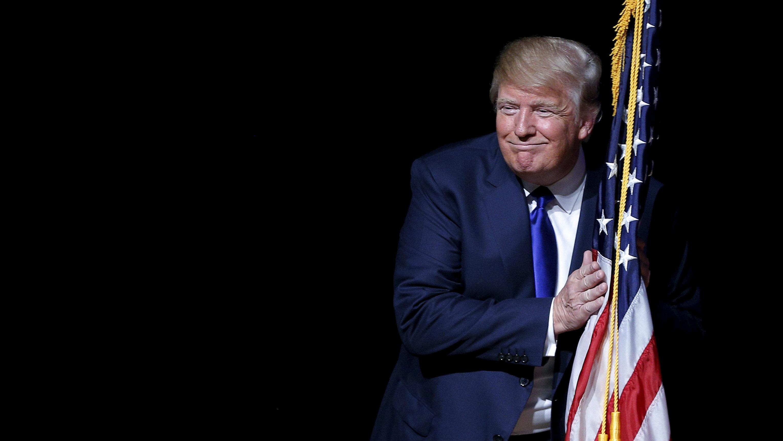 Donald Trump holds US flag