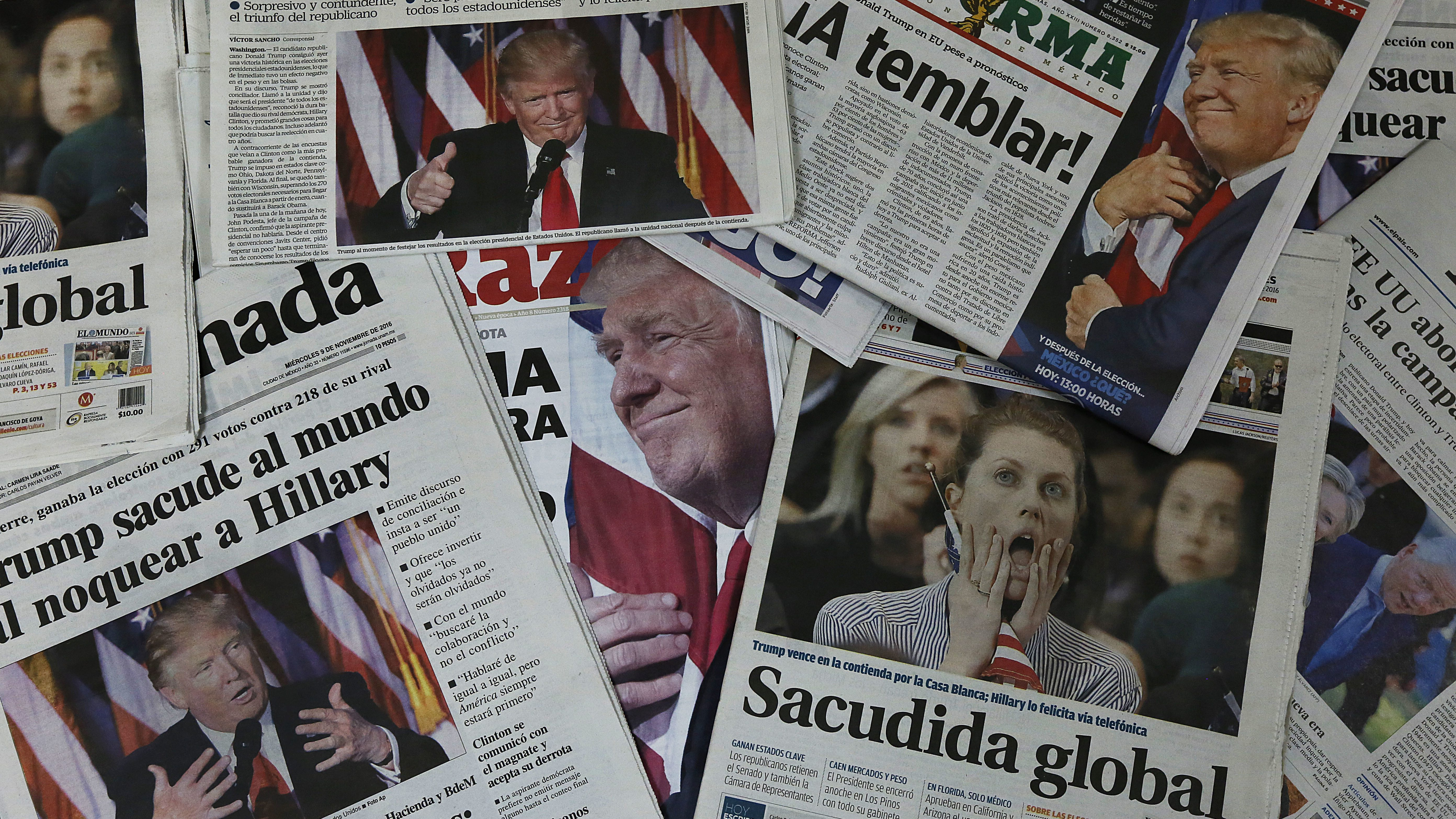 Mexican newspapers headline with Donald Trump's triumph over Hillary Clinton, in Mexico City, Wednesday, Nov. 9, 2016. President-elect Trump's victory ends eight years of Democratic dominance of the White House. Trump has pledged to usher in sweeping changes to U.S. foreign policy, including building a wall along the U.S.-Mexico border. (AP Photo/Marco Ugarte)