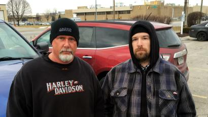 Brian Easton (left) and Brad Stepp, are two of 1,400 workers at Carrier Corporation (building in background) in Indianapolis, Indiana, February 17, 2016. Easton and Stepp stand to lose their job when the company moves production to Mexico. The Feb 9 announcement by United Technologies Corp's Carrier unit that it was shifting production to Mexico from the U.S. has thrust the long-term trend of U.S. manufacturing job decline to the foreground of the nation's election year agenda. Picture taken February 17, 2016.