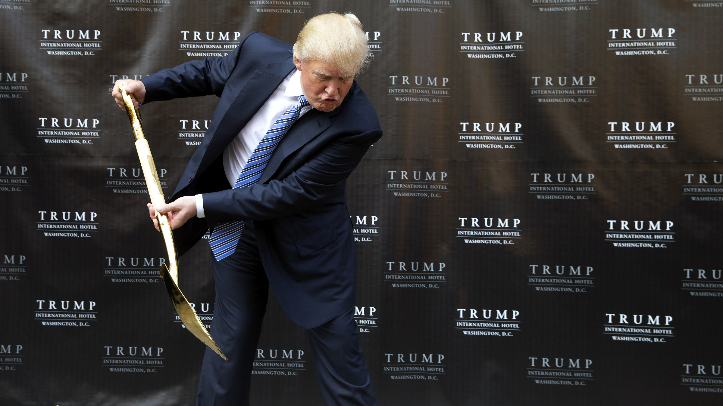 Donald Trump takes part in a ground breaking ceremony for the Trump International Hotel on the site of the Old Post Office, in Washington, Wednesday, July 23, 2014.