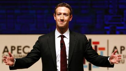 Mark Zuckerberg gestures while addressing the audience during a meeting of the APEC (Asia-Pacific Economic Cooperation) CEO Summit in Lima, Peru, November 19, 2016.