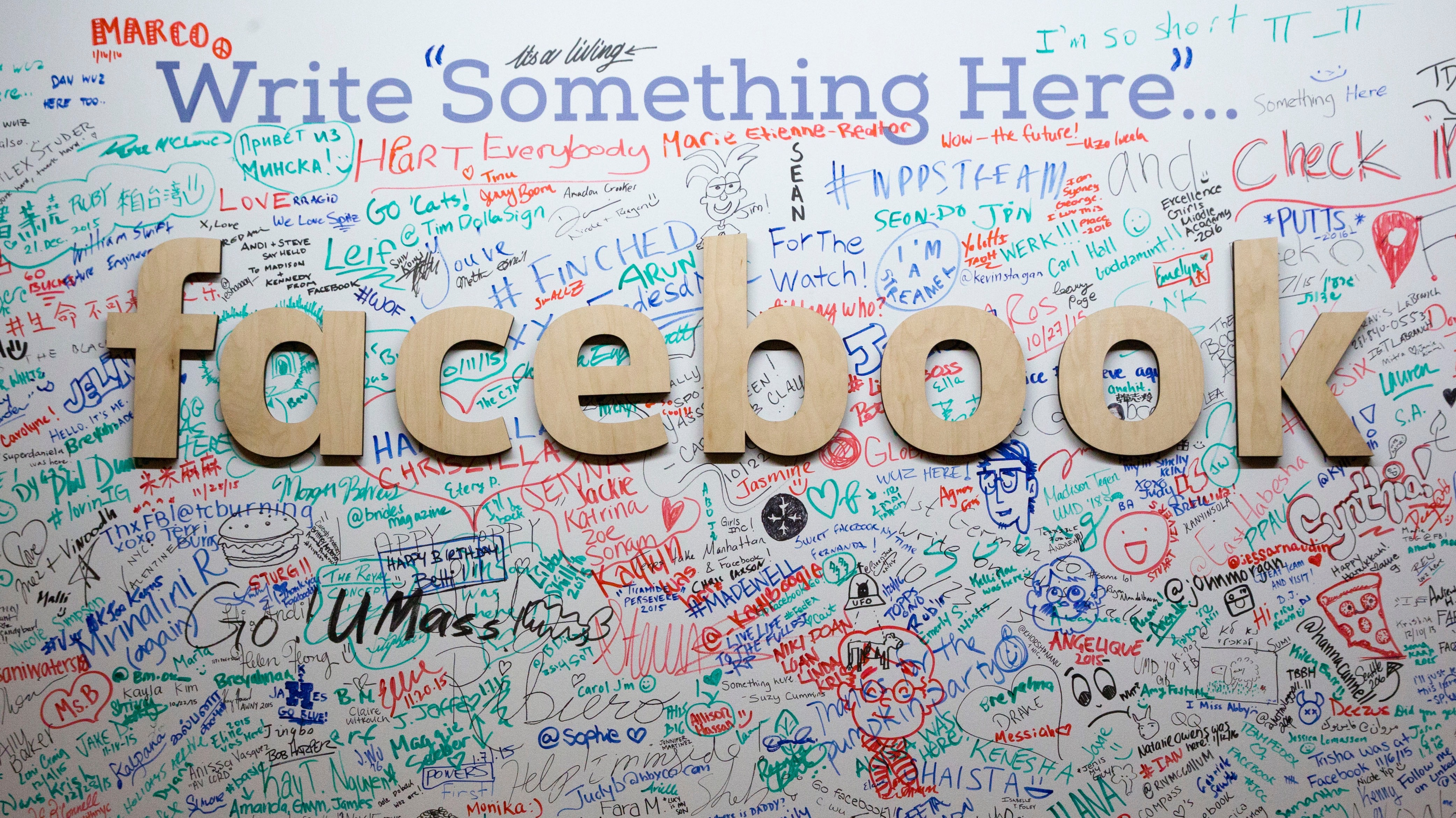 In this Thursday, Feb. 18, 2016 photo shows, the Facebook signature wall at the company's office in New York.  (AP Photo/Mary Altaffer)