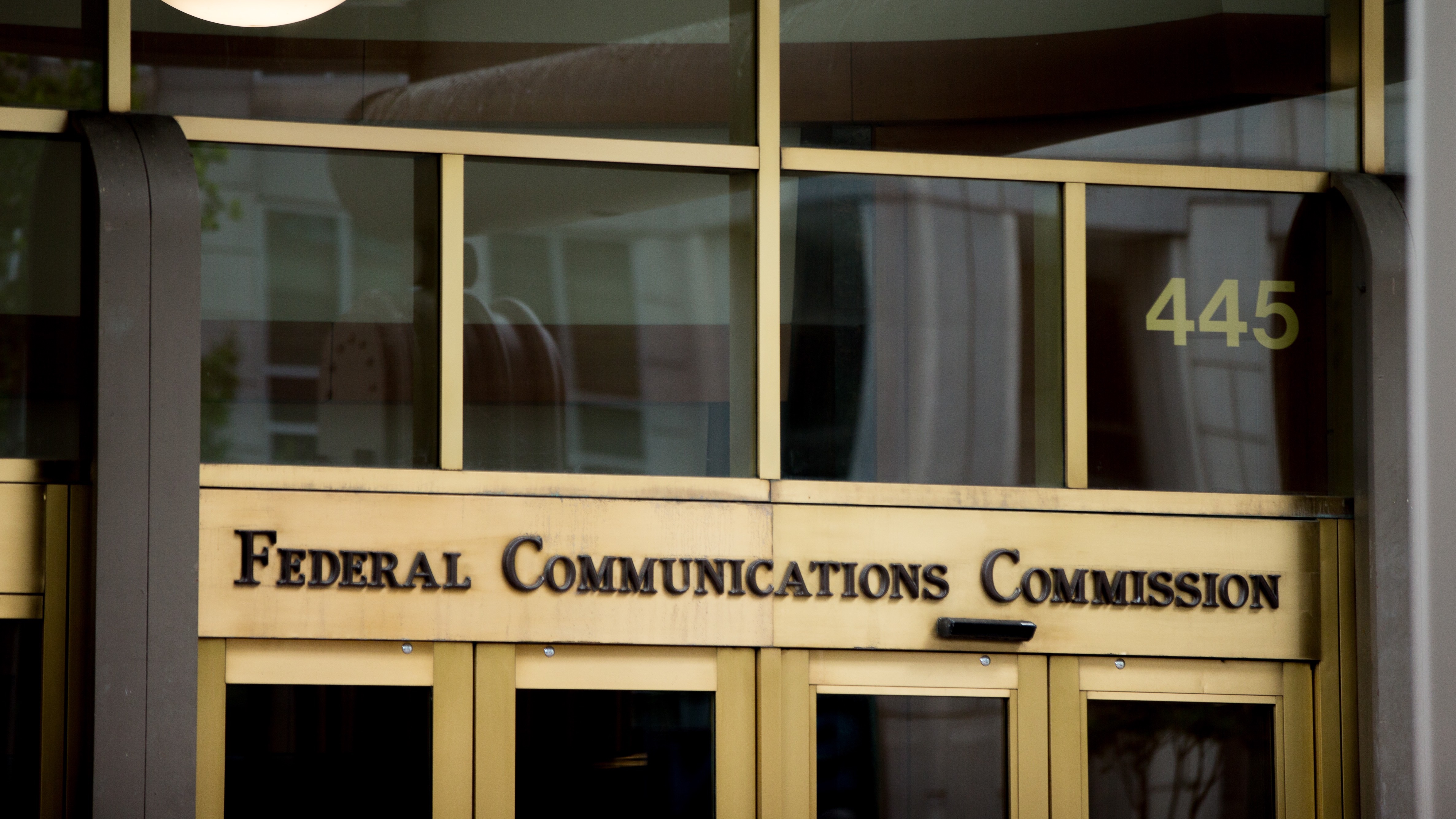 FILE - This June 19, 2015, file photo, shows the Federal Communications Commission building in Washington. Cellphone and broadband providers are excluding some video from data caps, meaning consumers have more data available for other apps and services. But the net neutrality rules from the Federal Communications Commission don't ban these practices, saying it could benefit consumers in some cases. (AP Photo/Andrew Harnik, File)