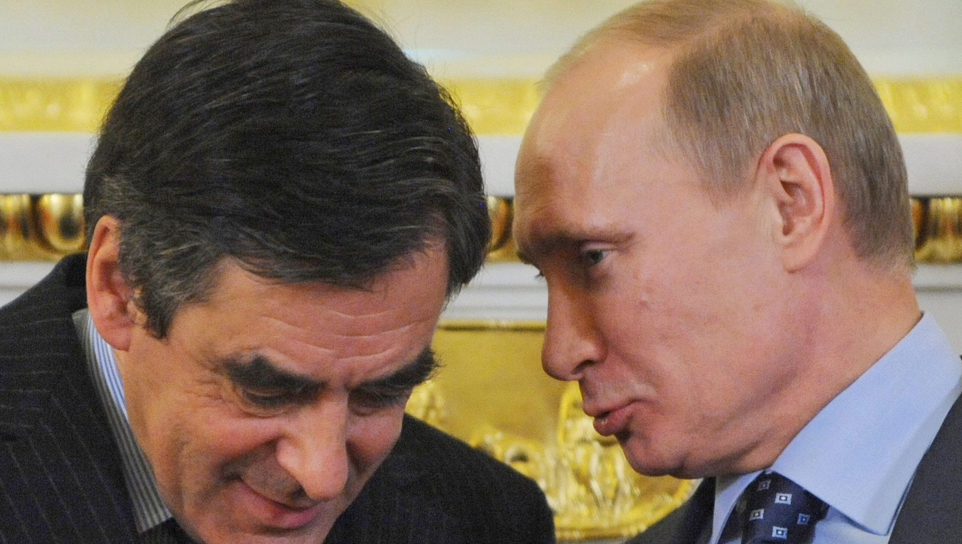 """Russian Prime Minister Vladimir Putin, right, and his  French counterpart Francois Fillon talk at a signing ceremony in Moscow, Friday, Nov. 18, 2011. Fillon who was meeting with Putin in Moscow on Friday said the international community must increase pressure on the Syrian regime """"so that Assad could not longer destabilize the situation in the region."""" (AP Photo/Natalia Kolesnikova, Pool)"""