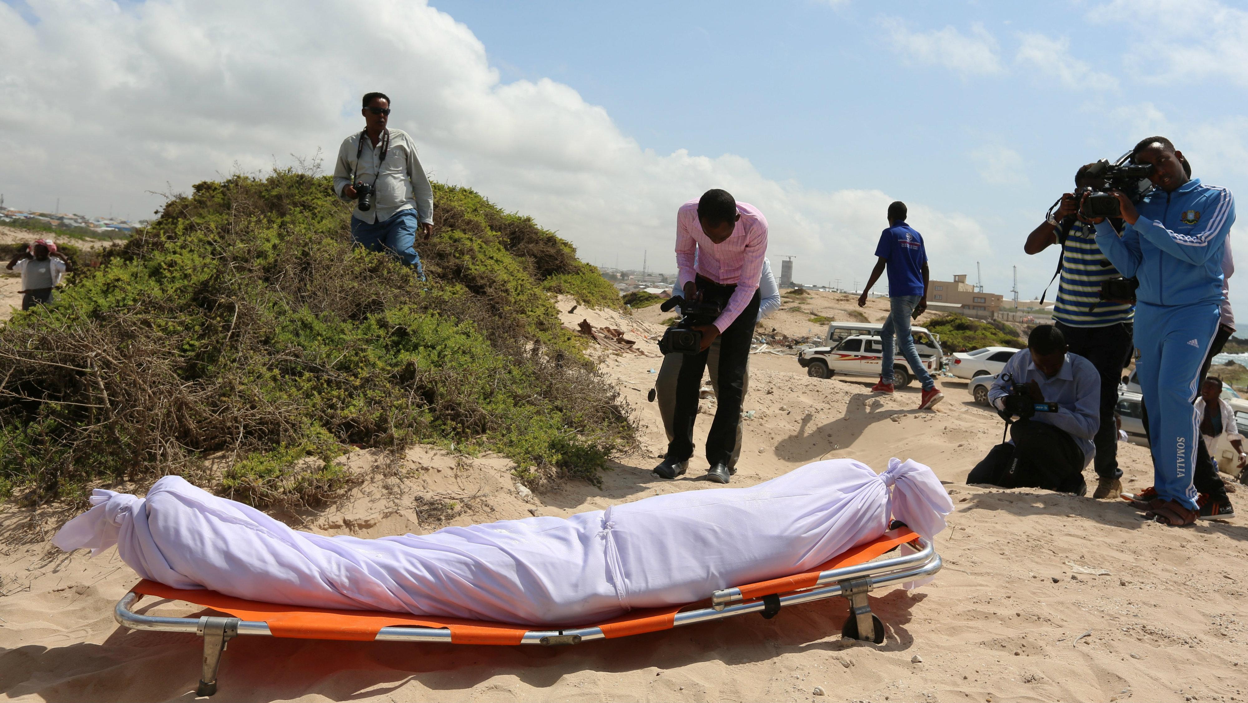 Journalist take photos during the funeral of Abdiasis Ali Haji, a Somali radio journalist who was killed by unknown gunmen in Somalia's capital Mogadishu, September 28, 2016.