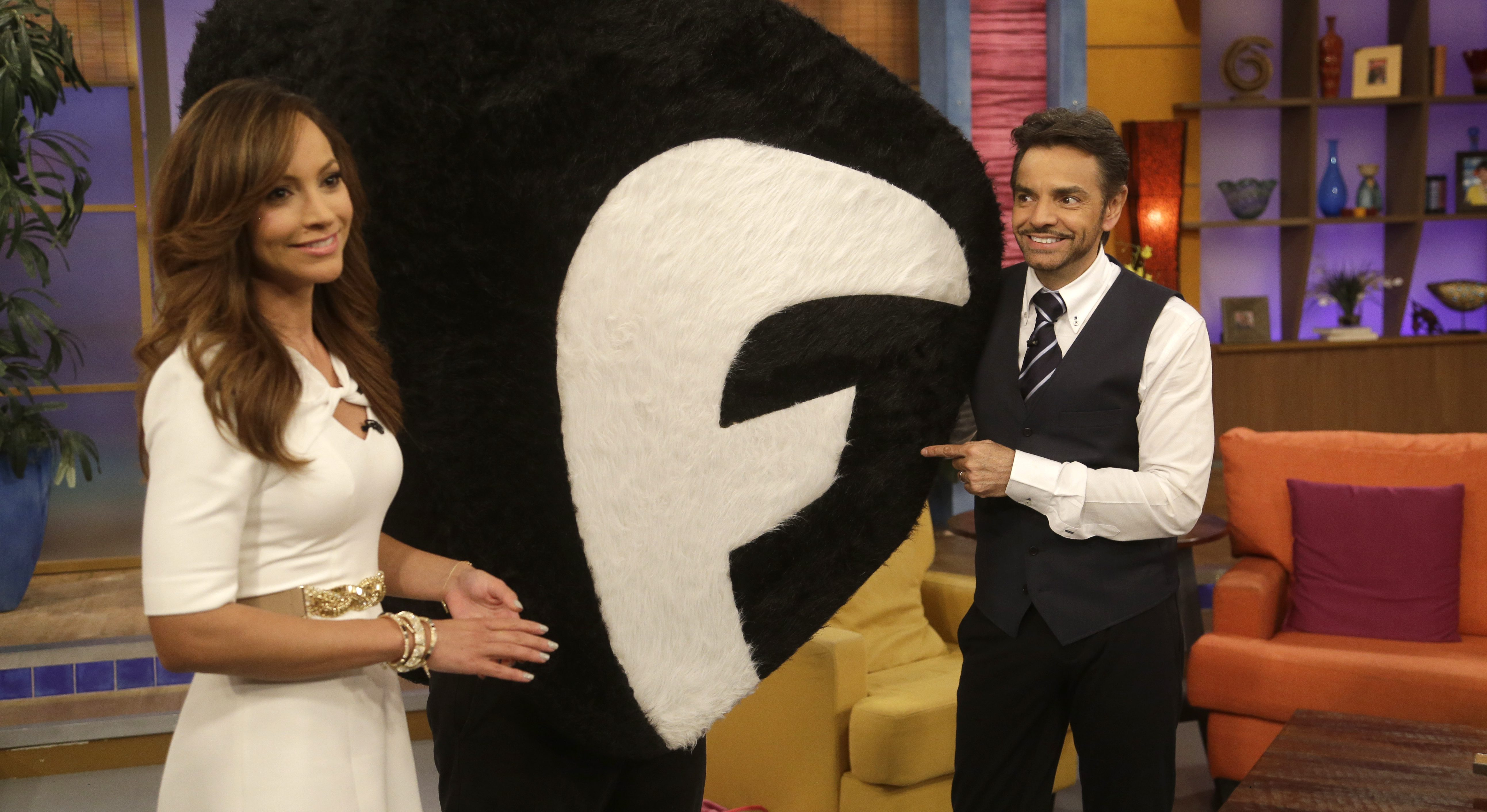 """Mexican actor Eugenio Derbez, right, and Satcha Pretto, left, pose with the new Fusion network mascot on the Univision network morning show, """"Despierta America"""" (""""Wake Up America,"""") Monday, Oct. 28, 2013 in Doral, Fla. (AP Photo/Wilfredo Lee)"""