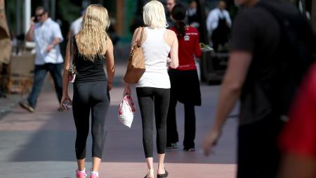 MIAMI BEACH, FL - FEBRUARY 12: A woman wearing yoga pants walk down the street on February 12, 2015 in Miami Beach, Florida. On Tuesday, Montana state Rep. David Moore introduced a bill that would expand the states existing indecent exposure laws to include tight pants such as yoga pants. (Photo by Joe Raedle/Getty Images)