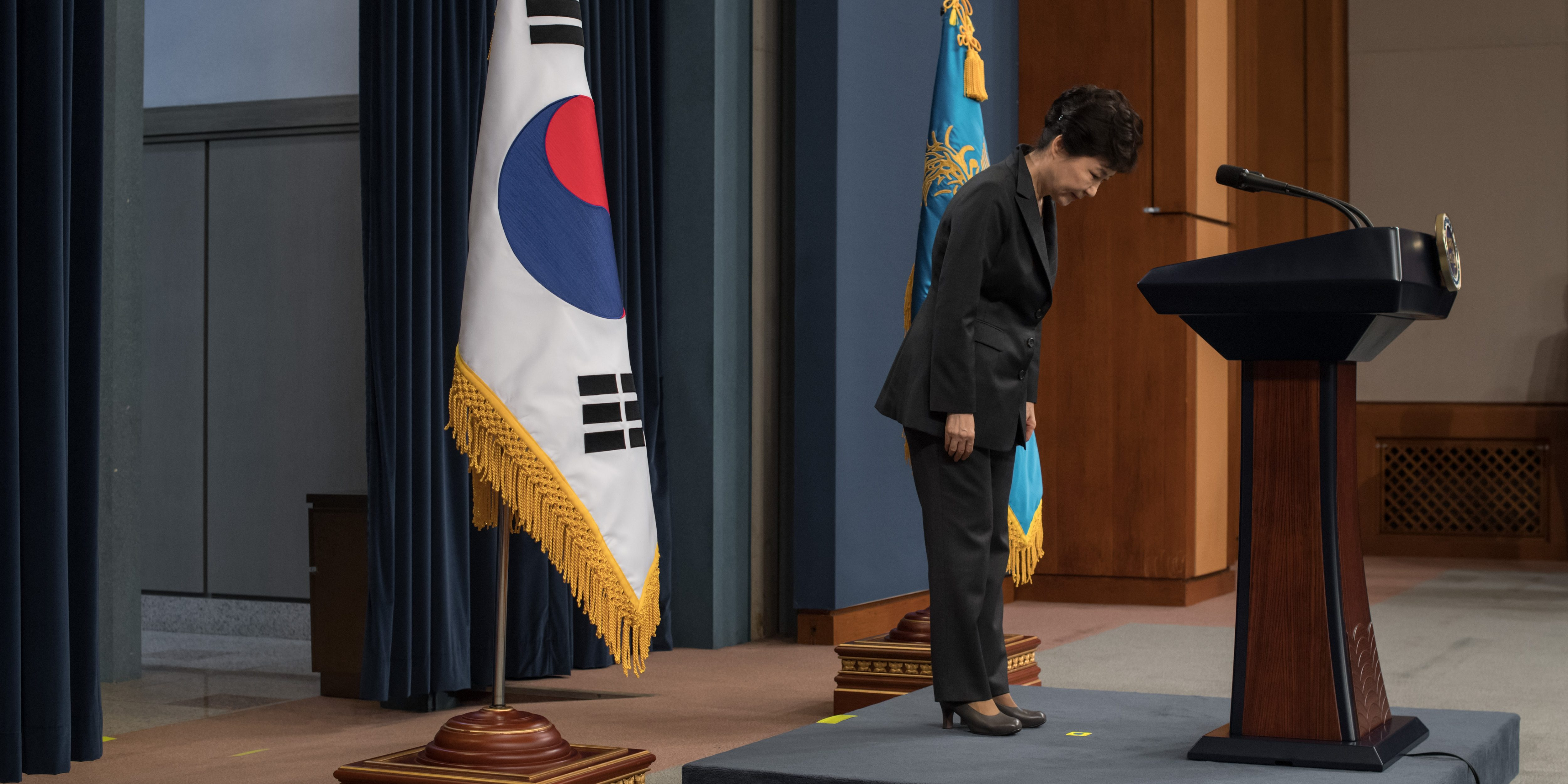 South Korean President Park Geun-Hye bows prior to delivering an address to the nation, at the presidential Blue House in Seoul, South Korea, 04 November 2016. Park agreed to submit to questioning by prosecutors investigating a corruption scandal engulfing her administration, accepting that the damaging fallout was 'all my fault.' In a televised address to the nation, Park denied some of the more lurid rumors surrounding the scandal -- including reports that she had fallen into a religious cult and conducted shamanist rituals in the presidential Blue House.  EPA/ED JONES/POOL