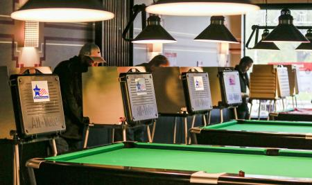 Voters mark their paper ballots near a row of pool tables at Pressure Billiards and Cafe in Chicago, Illinois, USA, 08 November 2016. Americans vote on Election Day to choose the 45th President of the United States of America to serve from 2017 through 2020. EPA/TANNEN MAURY