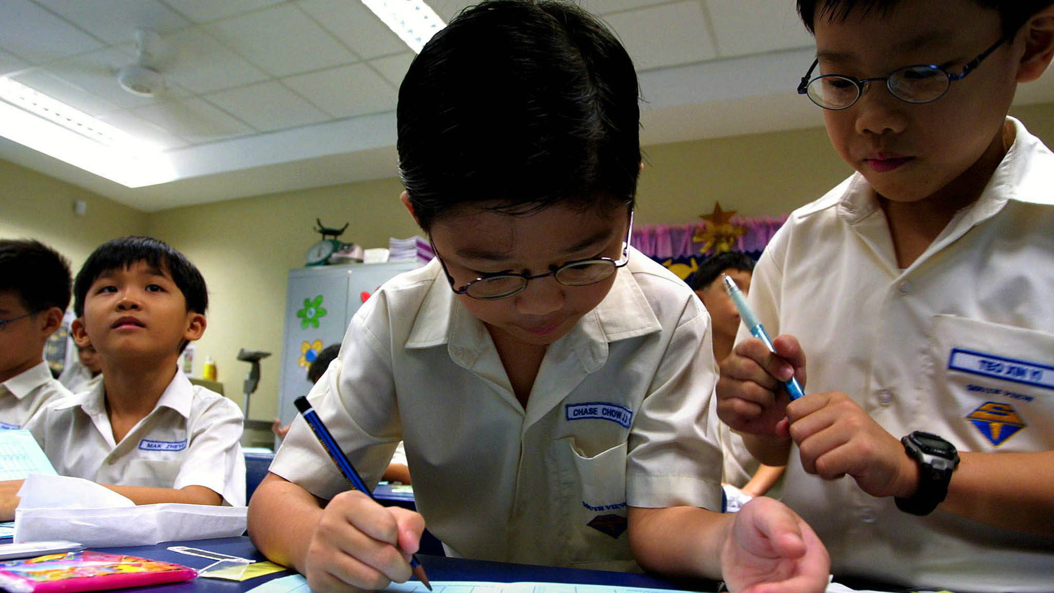 Children at the South View primary school in Singapore keep daily notes about their temperature, Monday 12 May 2003, as part of additional pre-cautionary measures taken by schools in the fight against SARS.