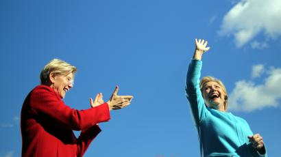 Democratic U.S. presidential nominee Hillary Clinton waves as she arrives to a campaign event accompanied by U.S. Senator Elizabeth Warren (D-MA) at Alumni Hall Courtyard, Saint Anselm College in Manchester, New Hampshire U.S., October 24, 2016.