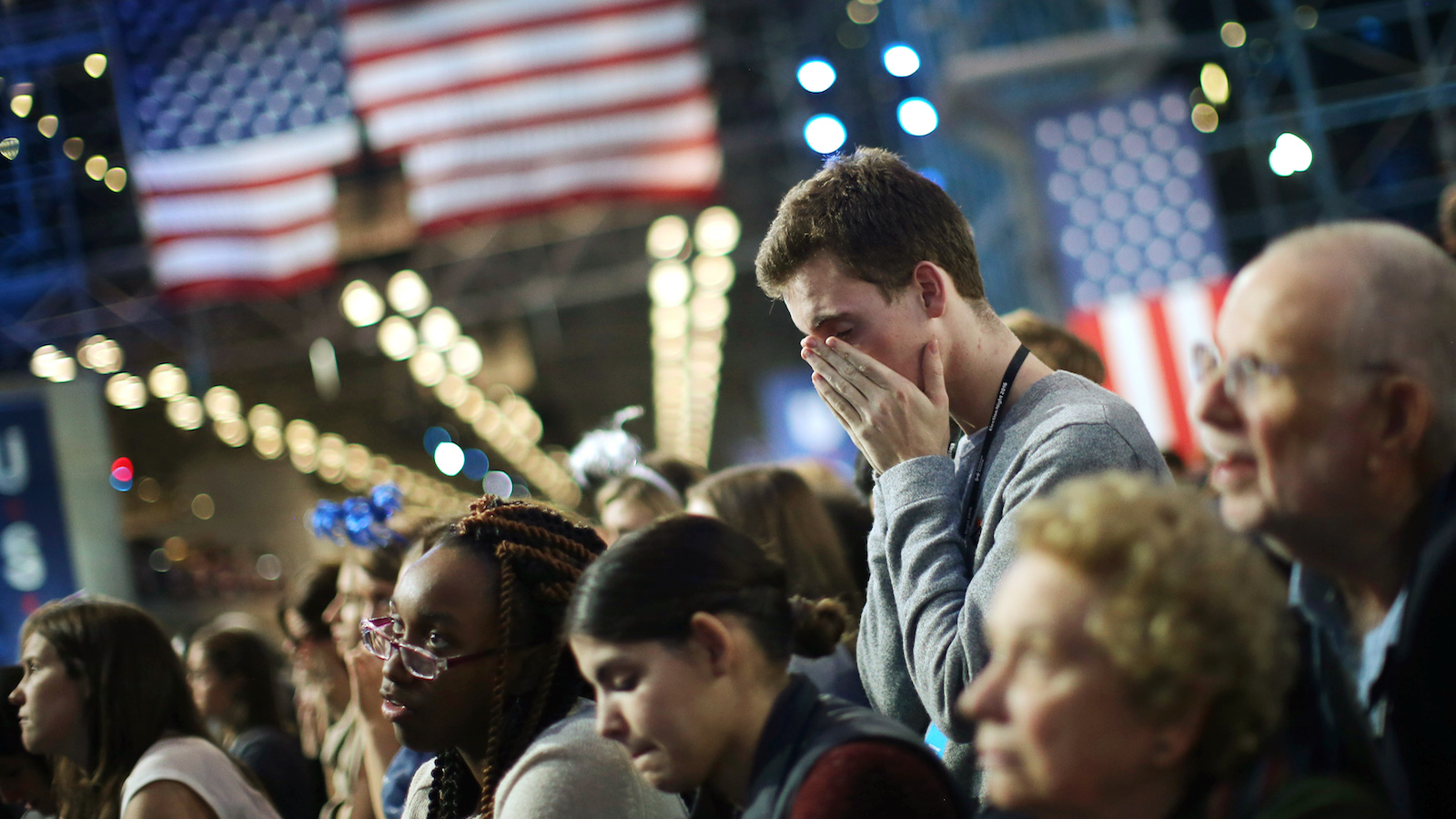Supporters of Democratic U.S. presidential nominee Hillary Clinton watch state by state returns at her election night rally in New York, U.S., November 8, 2016. REUTERS/Carlos Barria      TPX IMAGES OF THE DAY  - RTX2SO8N