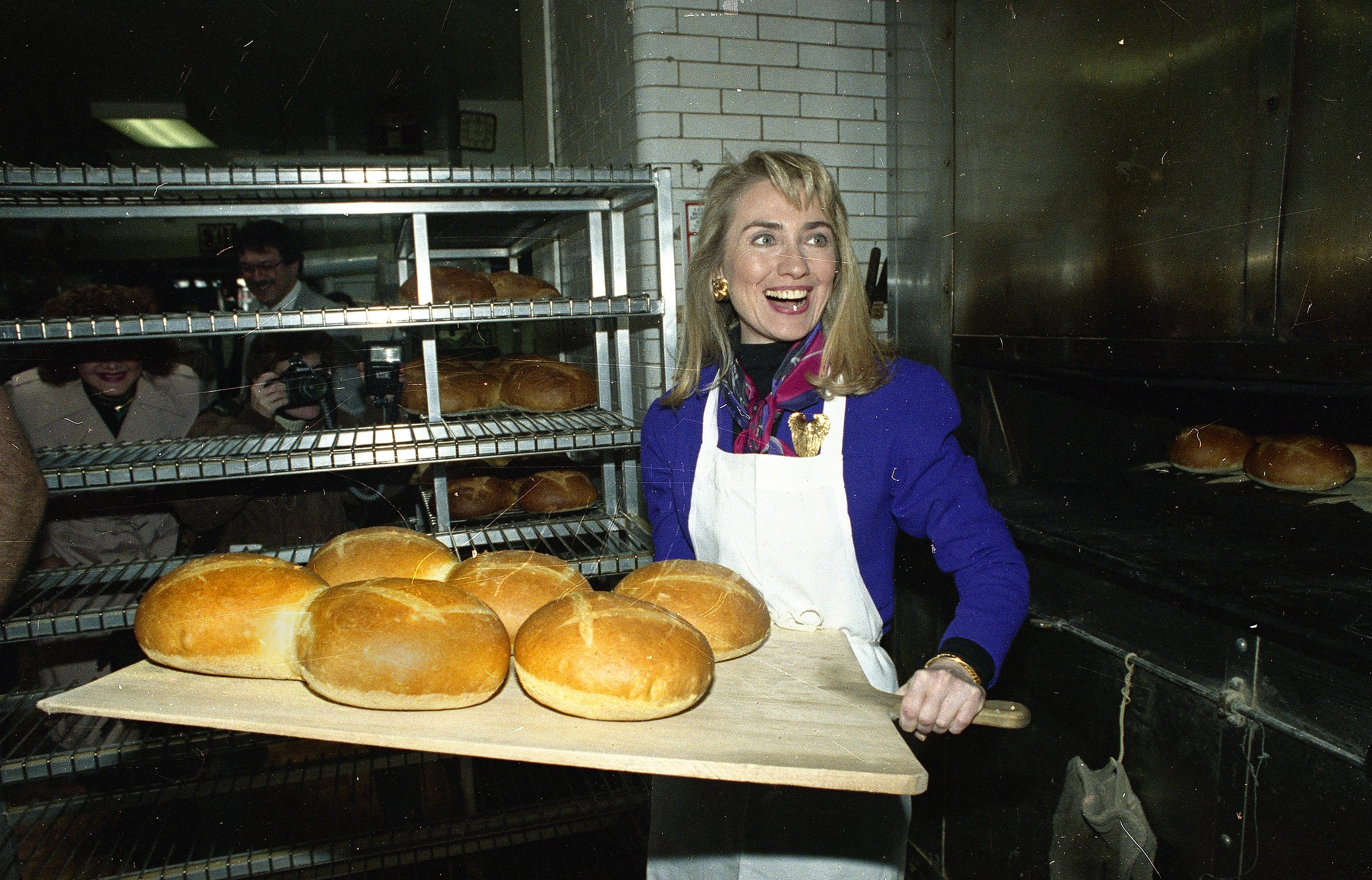 Hillary Rodham Clinton, wife of Democratic presidential hopeful BIll Clinton, removes several loaves of fresh bread from the oven of Panetteria Bakery in the Bronx borough of New York, April 3, 1992. Mrs. Clinton is campaigning in New York for her husband as the candidates prepare for New York's primary.