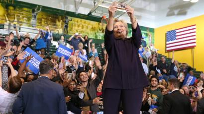 U.S. Democratic presidential nominee Hillary Clinton takes a selfie with the crowd at a voter registration rally at Wayne State University in Detroit