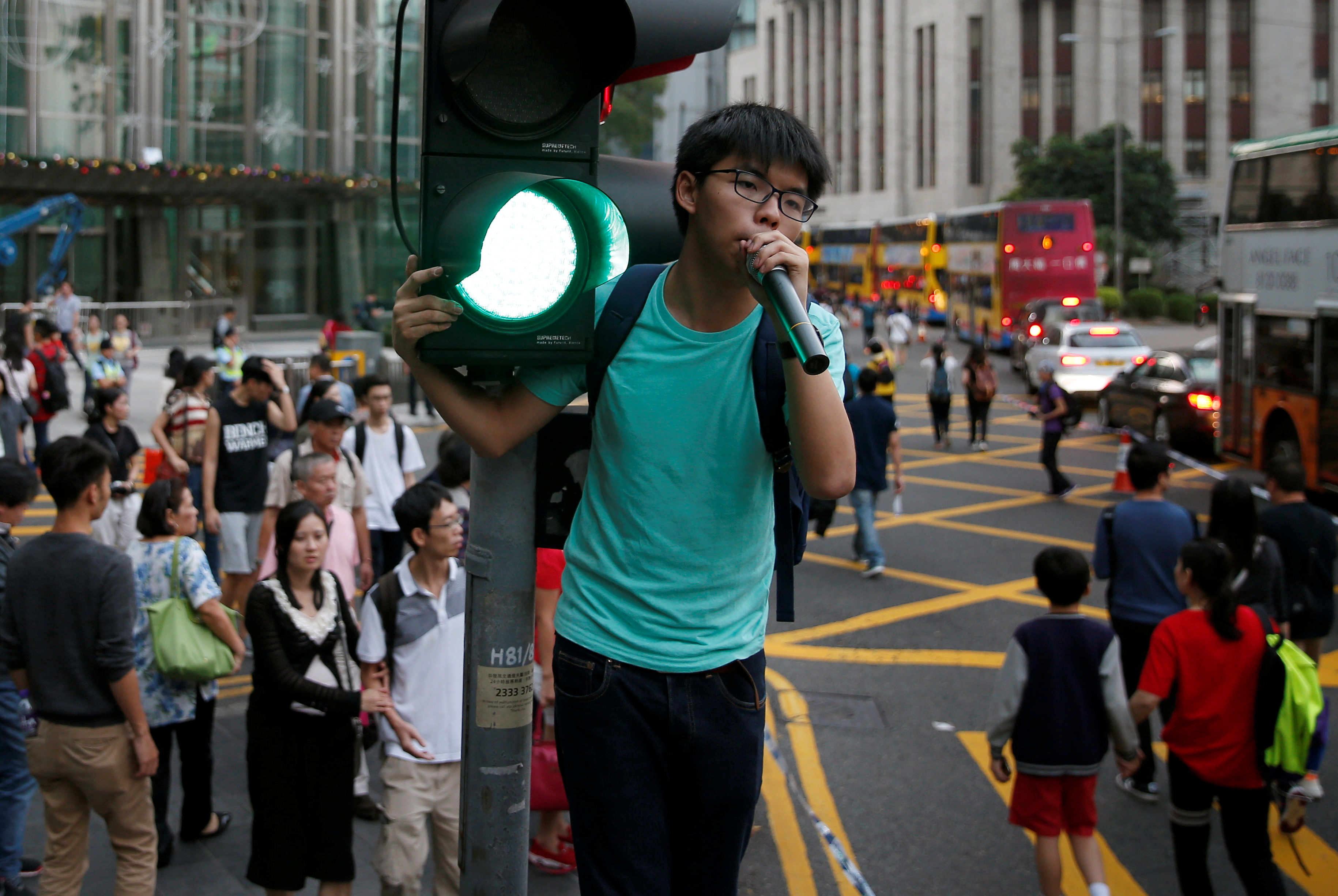Pro-democracy activist Joshua Wong shouts during a protest against what they call Beijing's interference over local politics and the rule of law a day before China's parliament is expected to announce their interpretation of the Basic Law in light of two pro independence lawmakers' oath-taking controversy in Hong Kong, China November 6, 2016. REUTERS/Tyrone Siu - RTX2S5DE