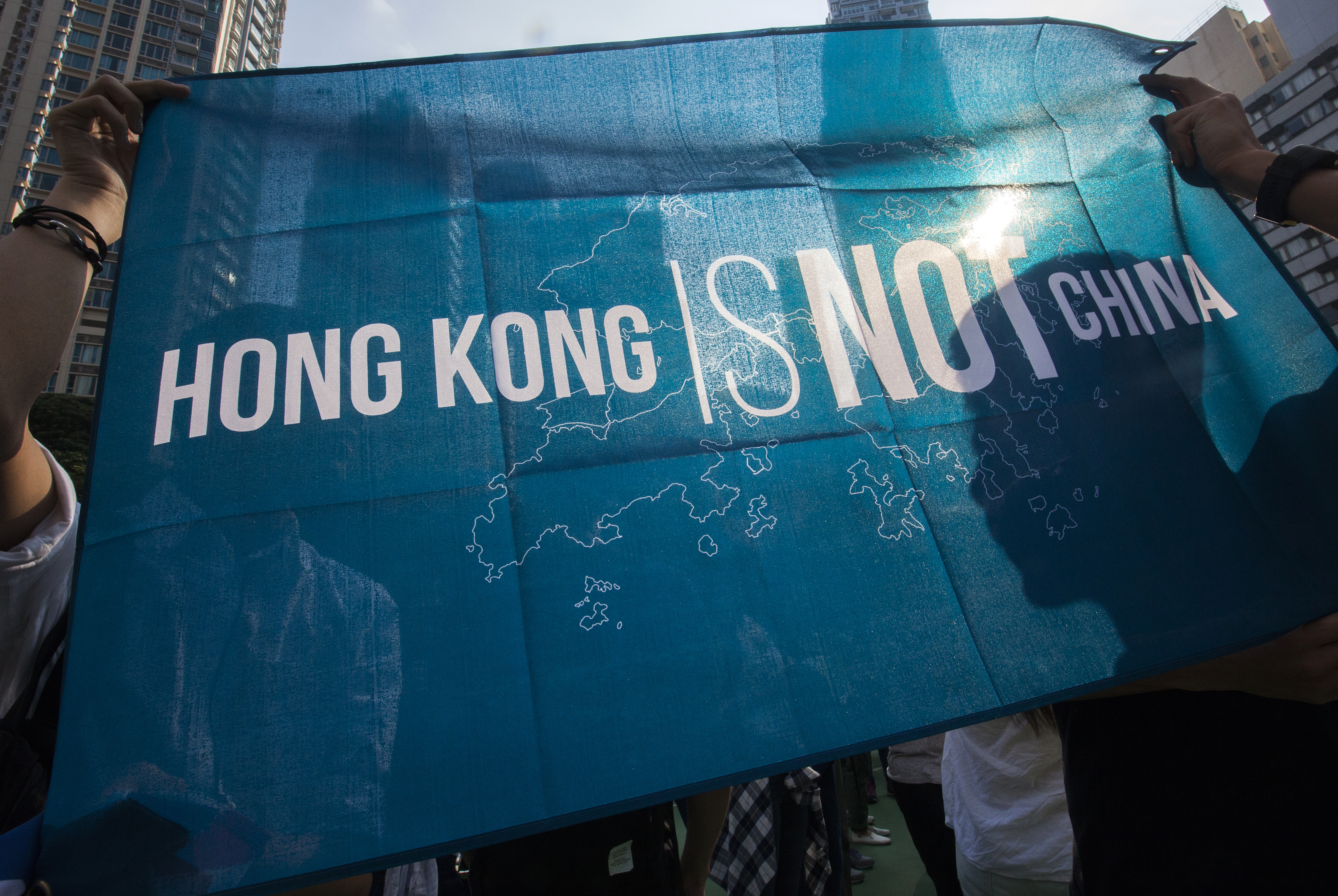 A man holds a 'Hong Kong is Not China' flag during a protest against the Legislative Council oath-taking interpretation of the city's Basic Law, or mini-constitution, by the Chinese authorities in Beijing, in Hong Kong, China, 06 November 2016. During their swearing-in ceremony in October 2016, councillors-elect Leung and Yau altered their oaths in a provocative move against mainland China and displayed pro-independent Hong Kong flags. The Standing Committee of the National People's Congress (NPC) plans to discuss to overturn the oathtaking and hence bar the elected councillors, which has sparked protests in Hong Kong. EPA/ALEX HOFFORD