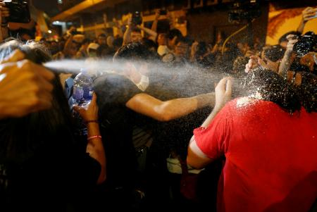 Protesters are pepper sprayed by police during a protest against what they call Beijing's interference over local politics and the rule of law, a day before China's parliament is expected to announce their interpretation of the Basic Law in light of two pro-independence lawmakers' oath-taking controversy in Hong Kong, China, November 6, 2016. REUTERS/Tyrone Siu - RTX2S5D7