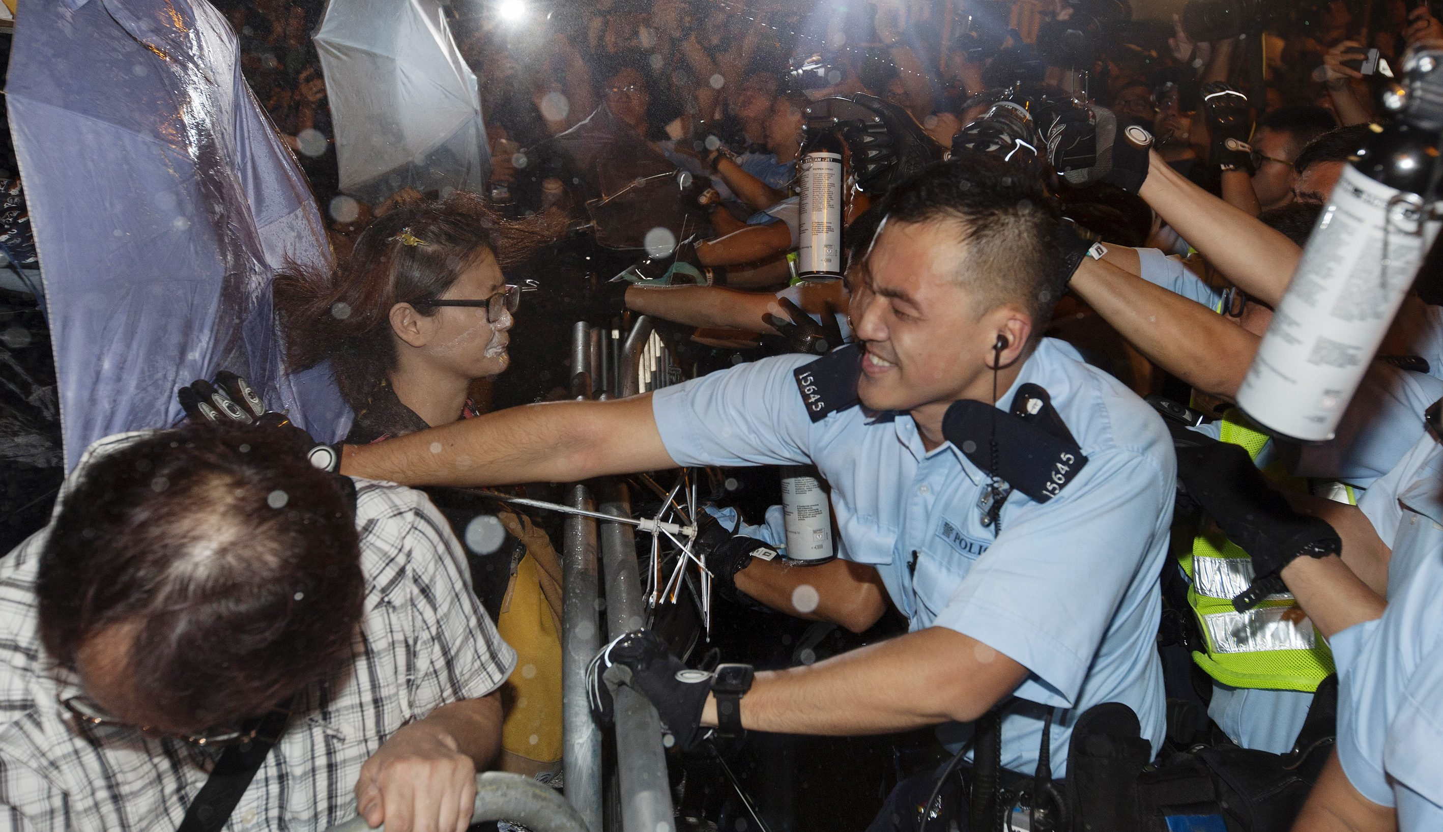 Police clash with protestors at a police barricade outside the Chinese government's headquarters in Hong Kong, China, 06 November 2016. Thousands of protestors marched through the streets of Hong Kong to protest against the Chinese government's controversial decision to decide the fate of two Hong Kong lawmakers who refused to pledge allegiance to the Hong Kong constitution and swore featly to the Hong Kong nation instead.  EPA/ALEX HOFFORD