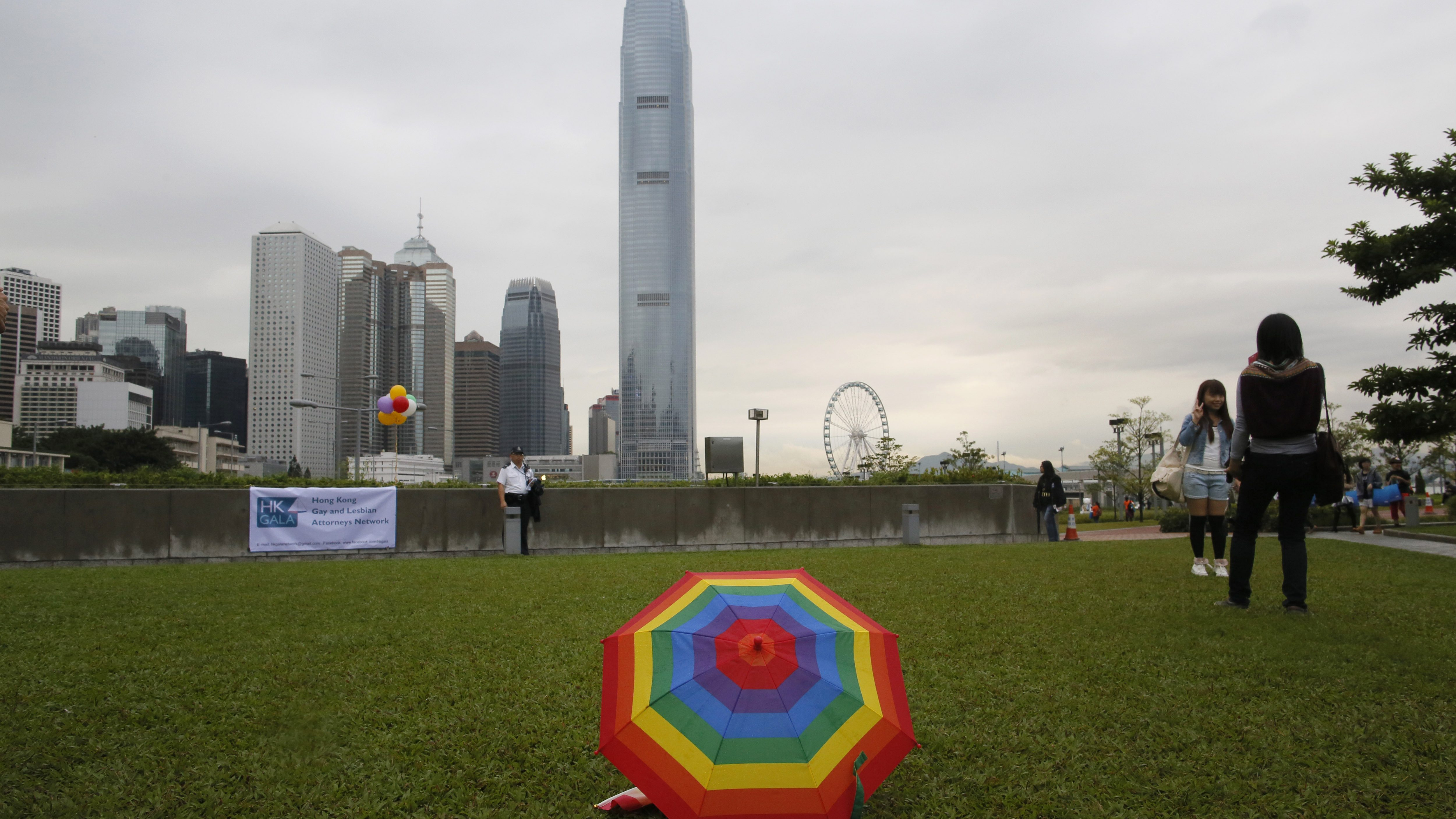 A rainbow umbrella is placed during a gay rally in Hong Kong Saturday, Nov. 8, 2014. Thousands of people took part in the annual Gay Pride Parade including representatives from the mainland and Taiwan. (AP Photo/Vincent Yu)