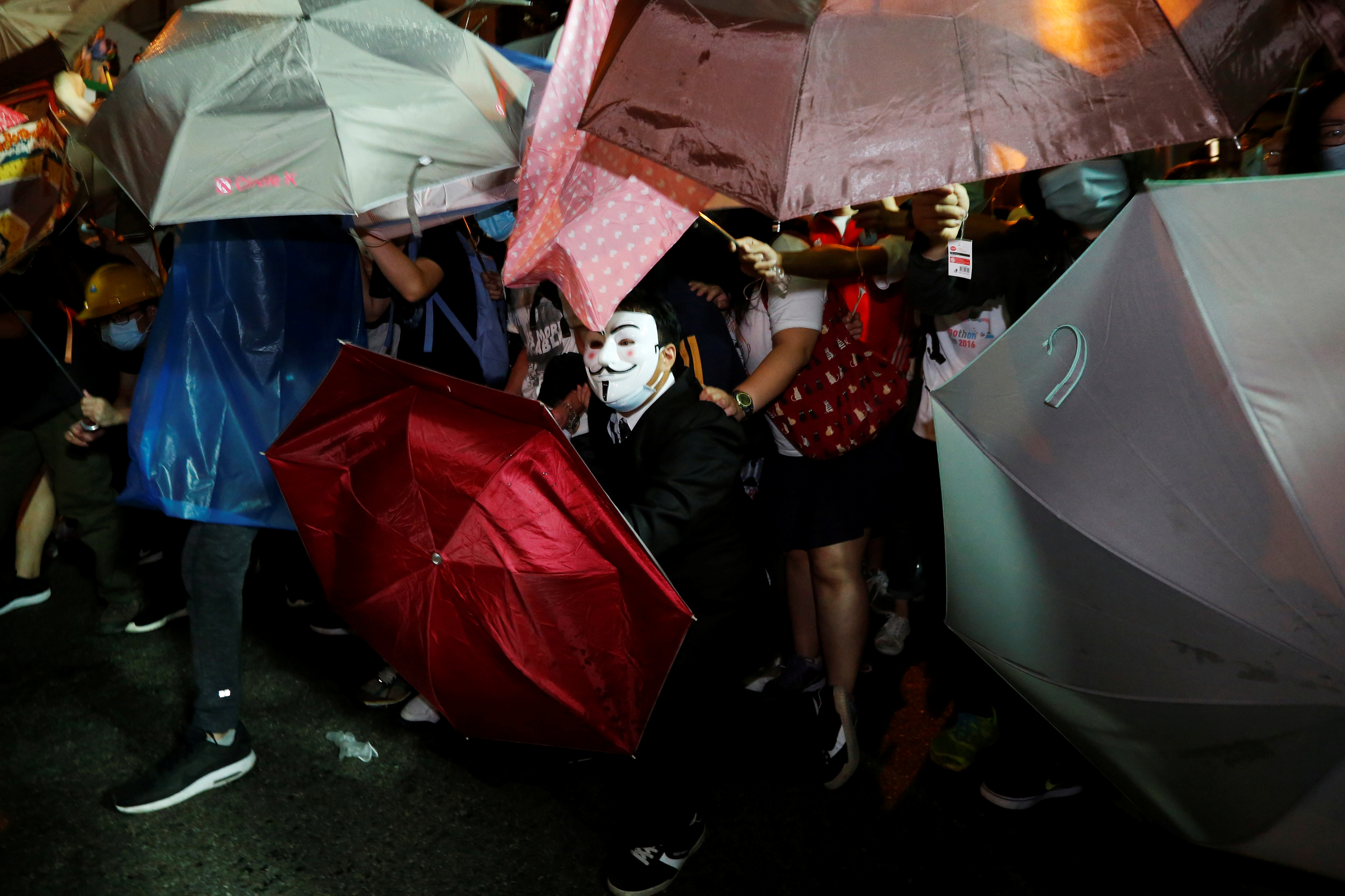 A protester wears Guy Fawkes mask during a confrontation with the police outside China Liaison Office in Hong Kong, China, November 6, 2016. REUTERS/Bobby Yip - RTX2S652
