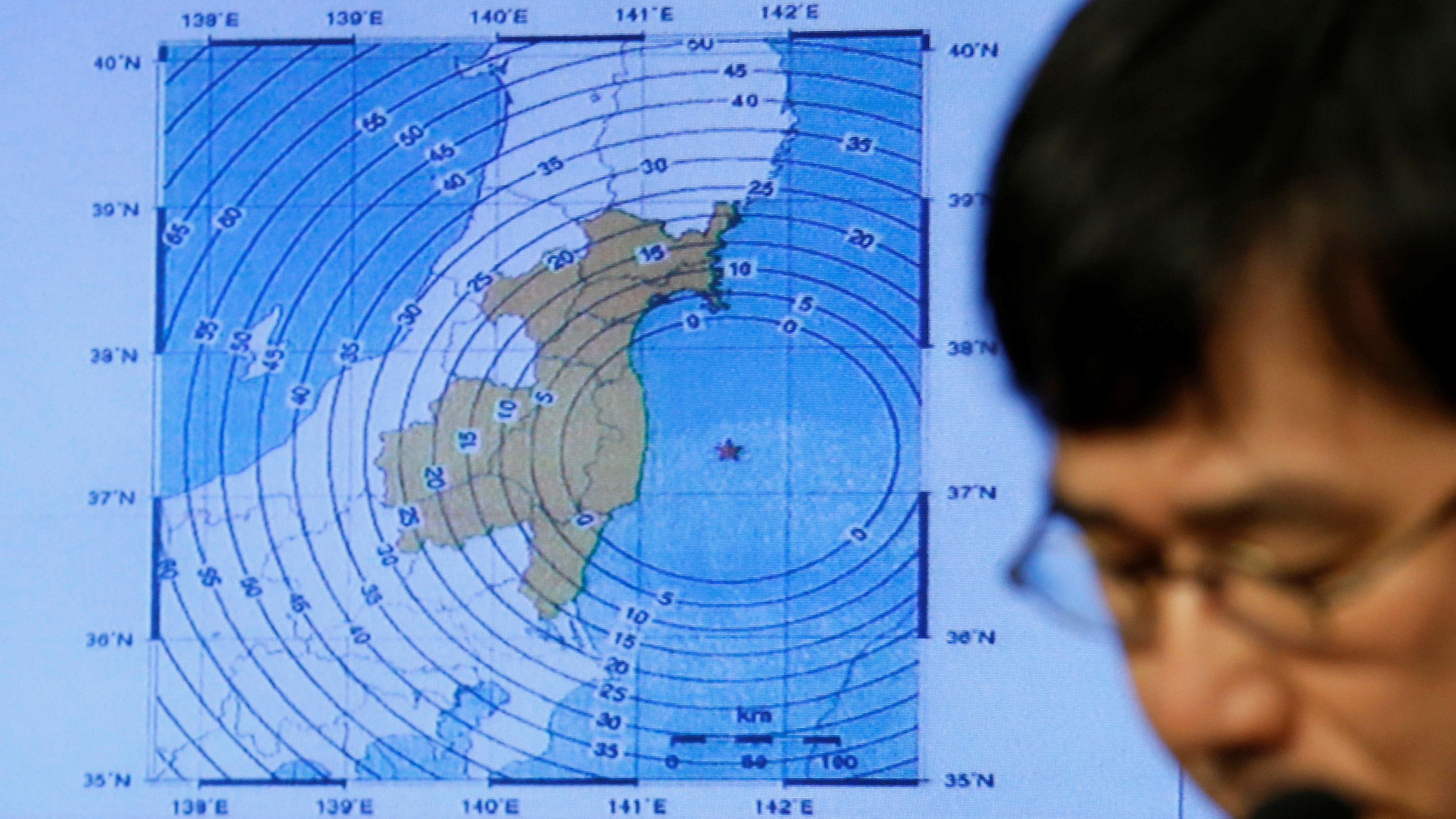 Japan Meteorological Agency's earthquake and volcano observations division director Koji Nakamura addresses a news conference next to the map showing an earthquake epicentre off the coast of Fukushima prefecture, in Tokyo, Japan November 22, 2016. Reuters/Toru Hanai - RTSSPPY