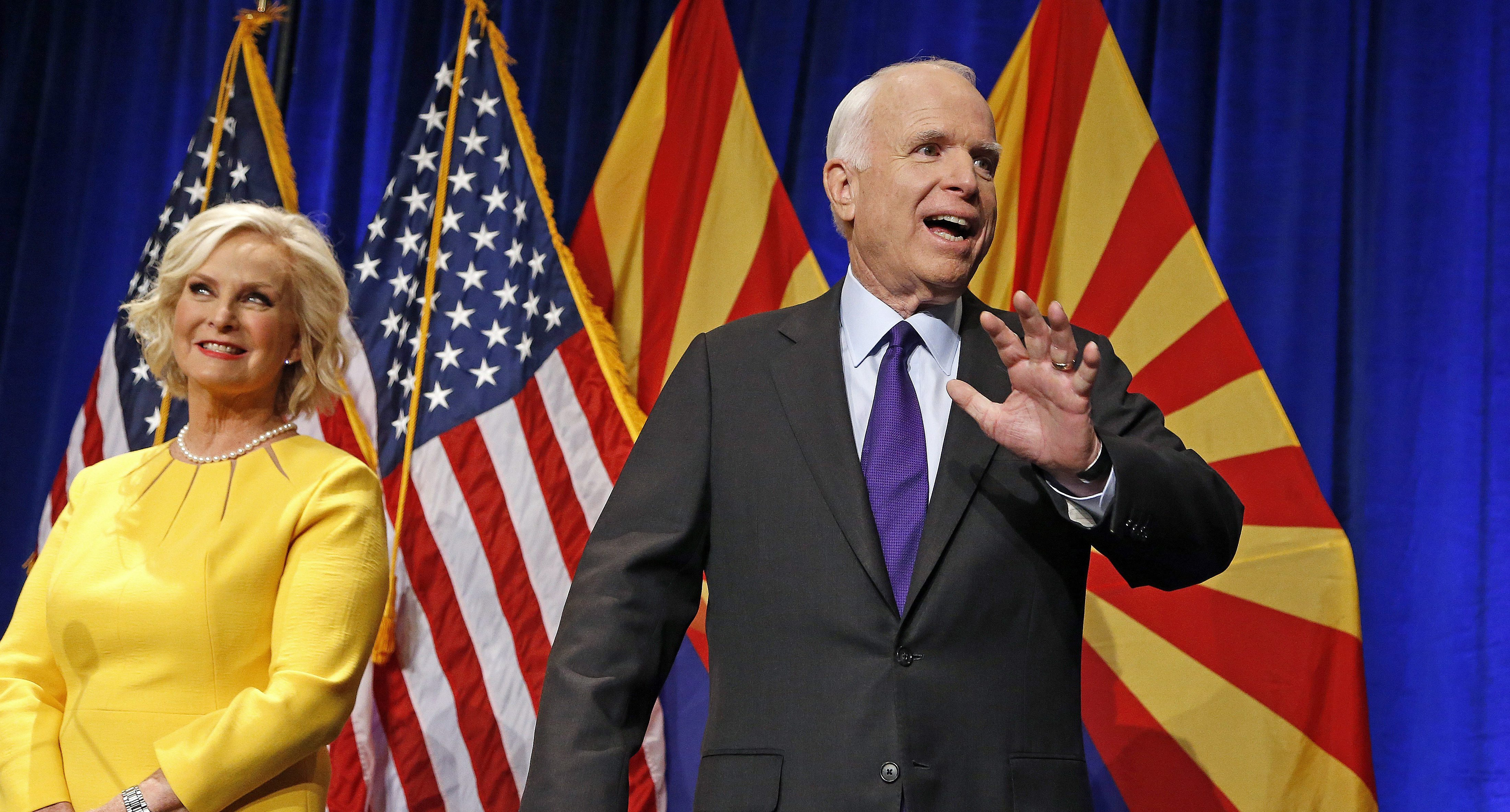 Sen. John McCain, R-Ariz., right, waves to supporters at his victory party as wife Cindy McCain, left, joins him on stage as he announces his victory over Democratic challenger  Rep. Ann Kirkpatrick Tuesday, Nov. 8, 2016, in Phoenix.