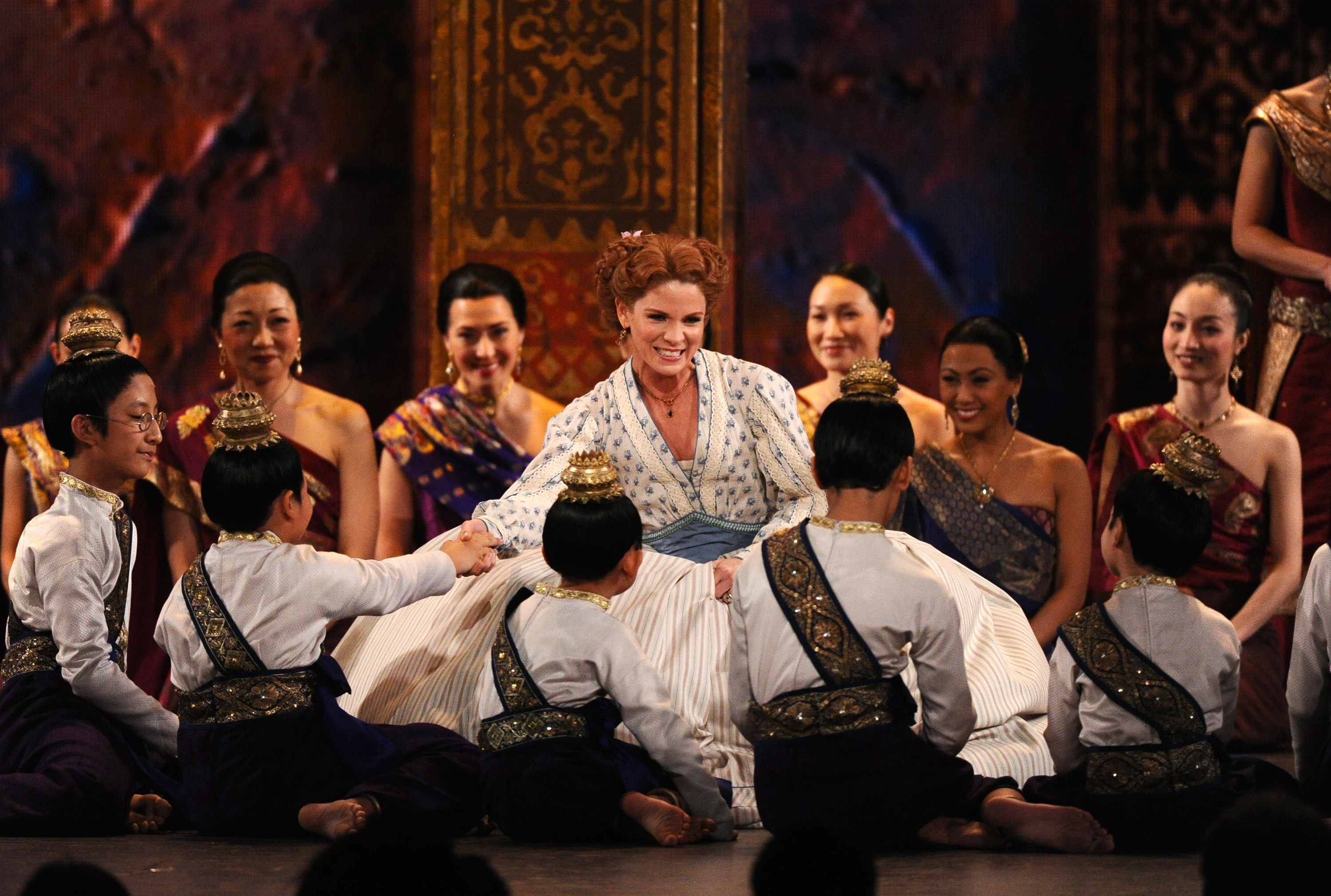 "Kelli O'Hara, center, and the cast of ""The King and I"" perform at the 69th annual Tony Awards at Radio City Music Hall on Sunday, June 7, 2015, in New York."
