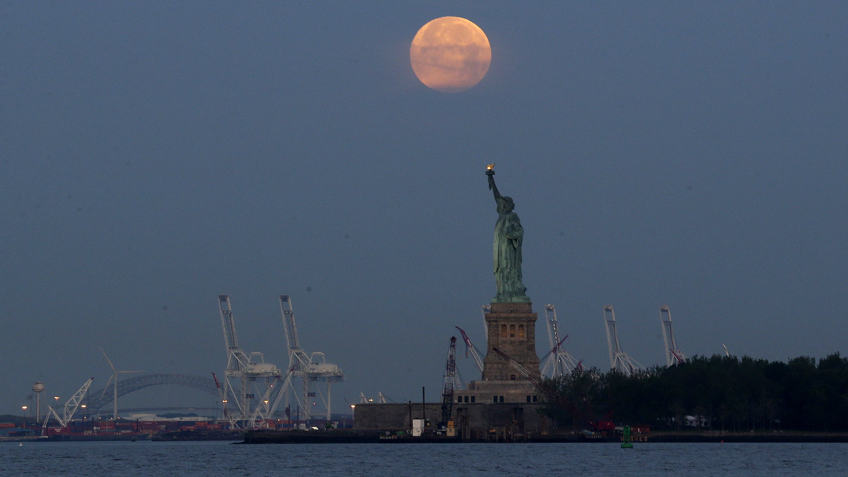This Sunday, June 23, 2013 file photo shows a supermoon over the Statue of Liberty in New York. Monday, Nov. 14,