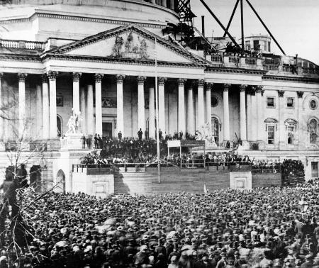 U.S. President Abraham Lincoln stands under cover at center of Capitol steps during his inauguration in Washington, D.C., on March 4, 1861. The scaffolding at upper right is used in construction of the Capitol dome.