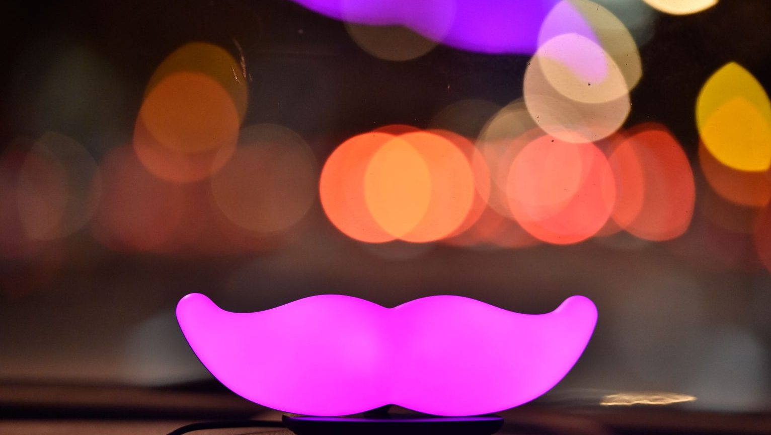 A Lyft Glowstache glows on the dashboard of a car in San Francisco on Feb. 03, 2016. (Josh Edelson/AP Images for Lyft)