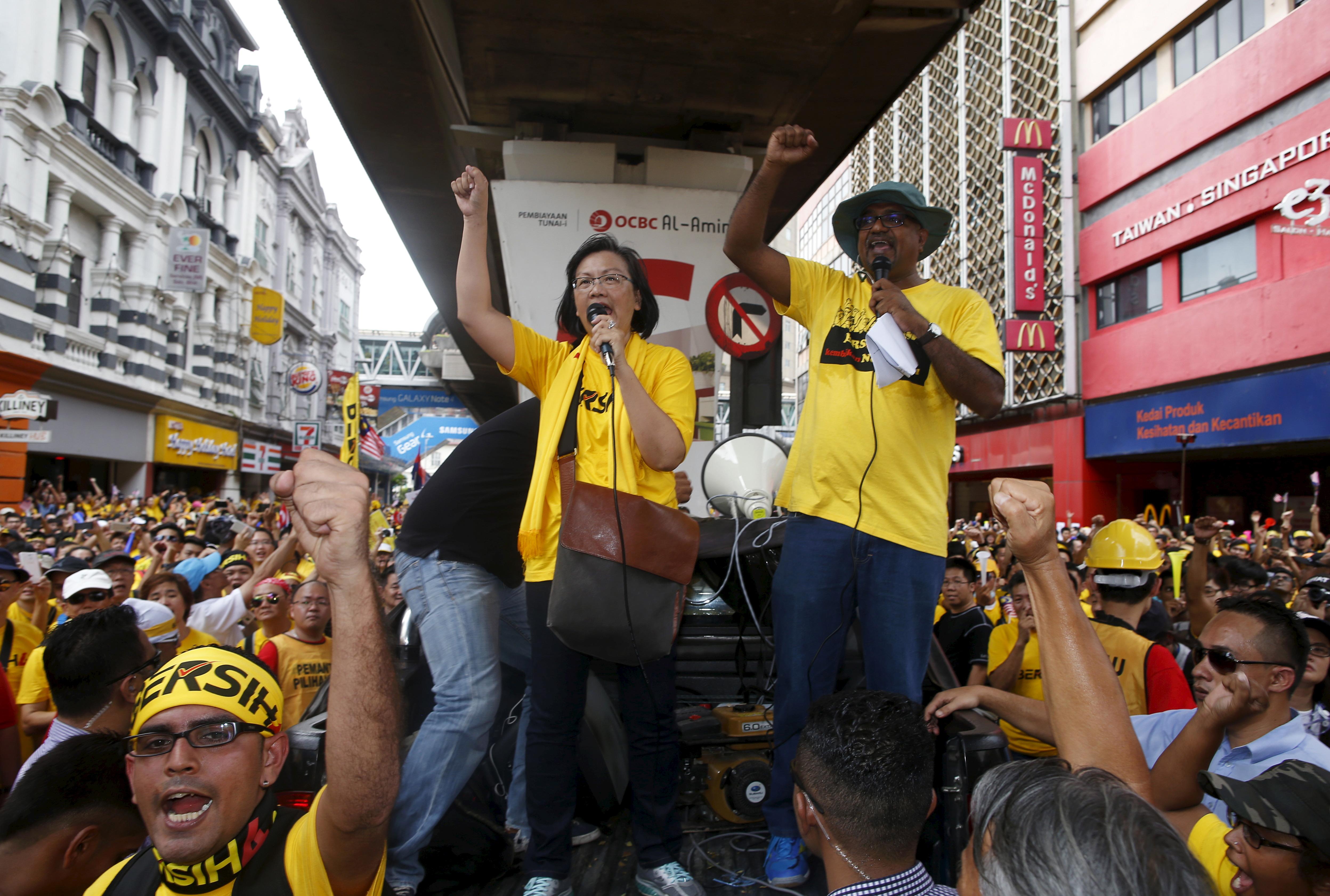"Pro-democracy group ""Bersih"" (Clean) chairwoman Maria Chin Abdullah rallies supporters as they prepare to march towards Dataran Merdeka in Malaysia's capital city of Kuala Lumpur"