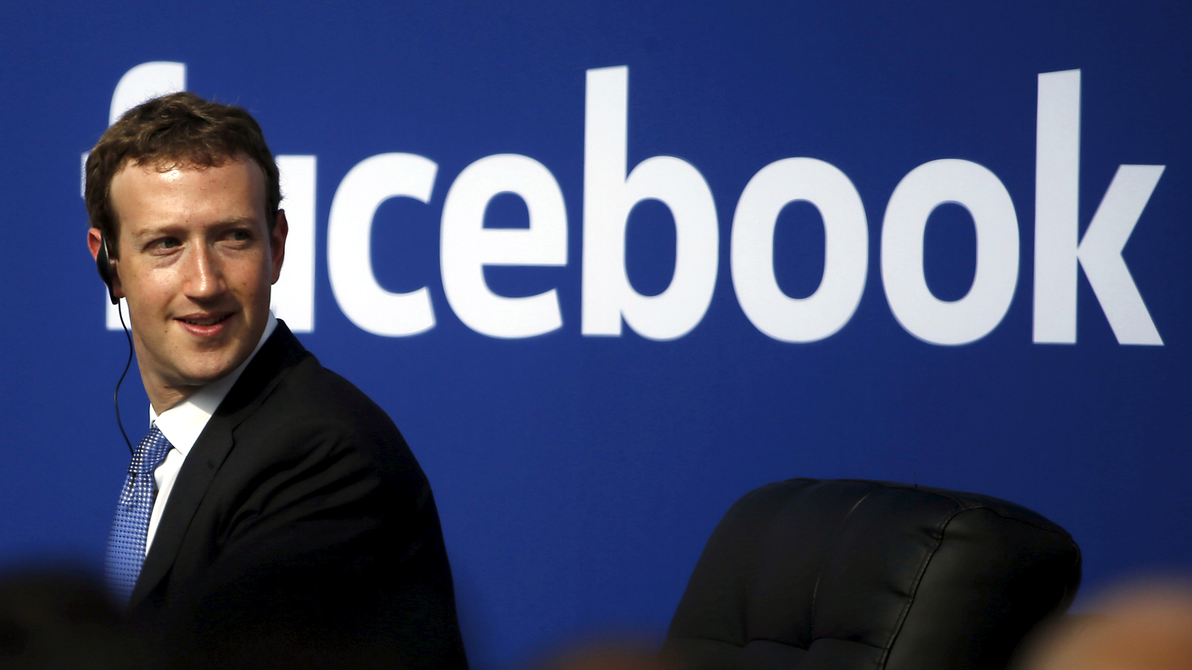 Facebook CEO Mark Zuckerberg is seen on stage during a town hall at Facebook's headquarters in Menlo Park, California September 27, 2015. Picture taken February 27, 2015.