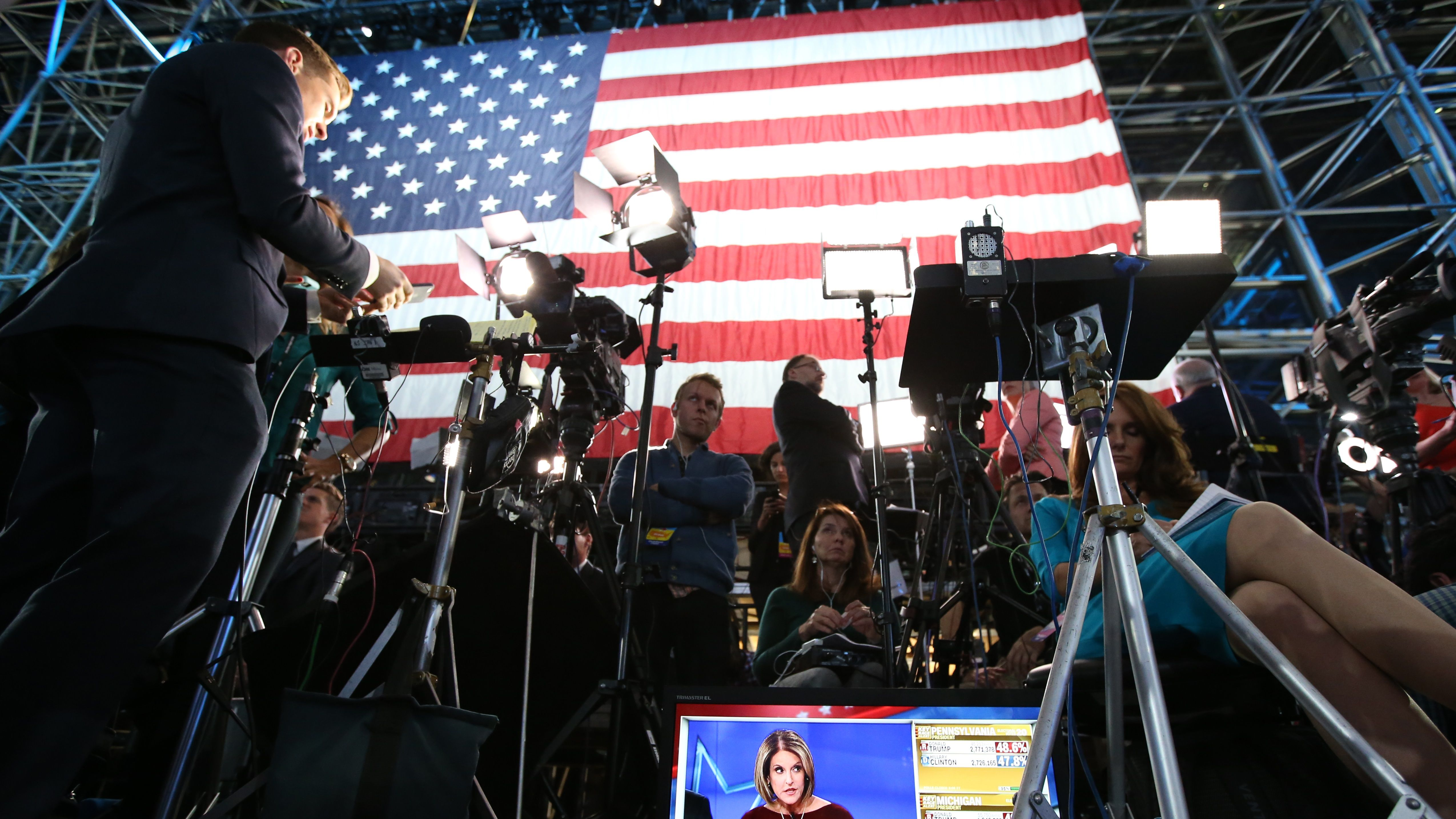 Media work at the election night rally for U.S. Democratic presidential nominee Hillary Clinton in Manhattan, New York, U.S., November 8, 2016.