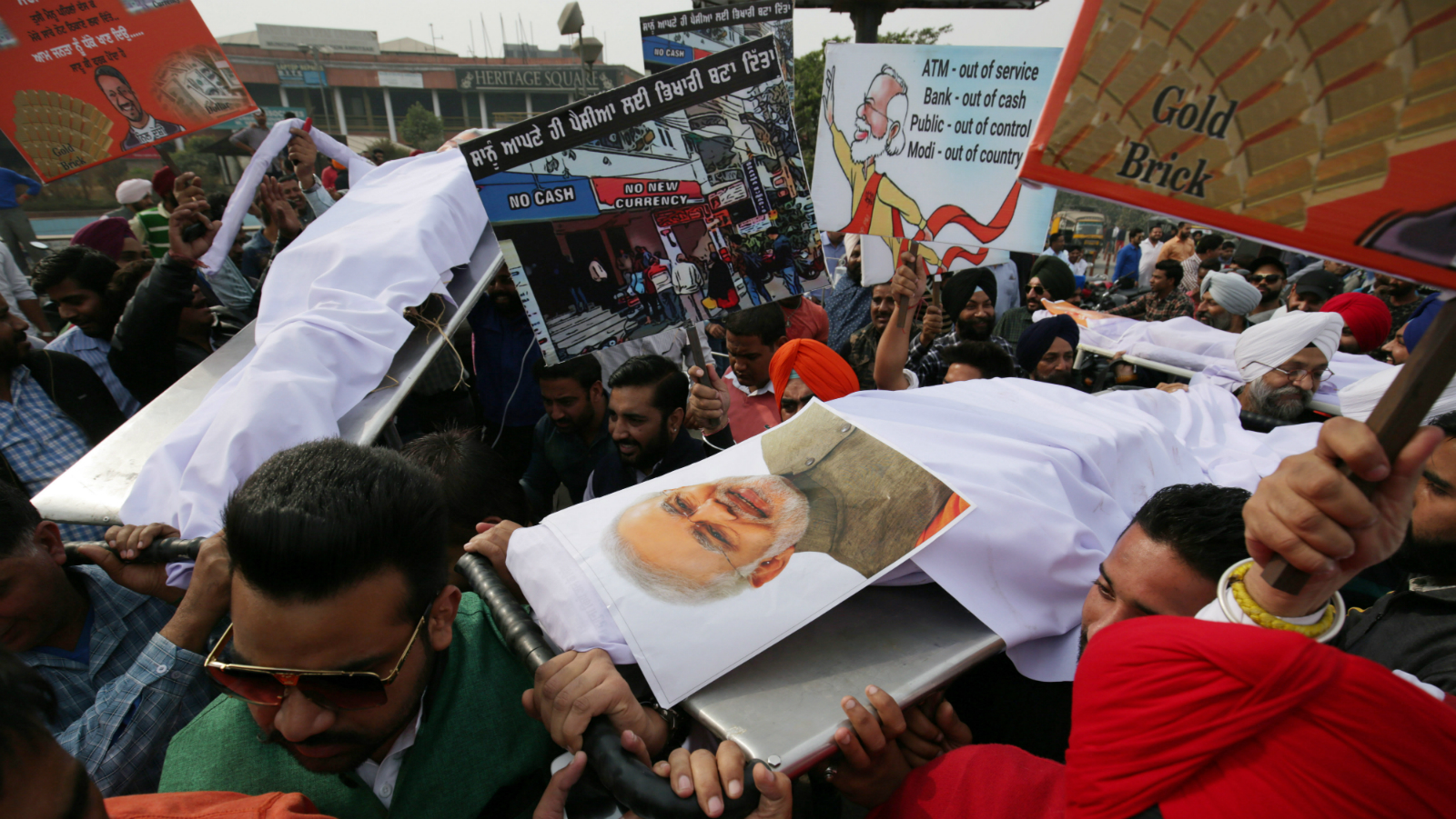 Congress party workers carry effigies representing Indian Finance Minister, Arun Jaitley, Indian Prime Minister Narendra Modi and Bharatiya Janata Party (BJP) President Amit Shah, on stretchers before buring them as they stage a protest against the government, opposing the ban on old high denomination currency notes in Amritsar, India, 21 November 2016. The protest was held against alleged anti-people policies of old 500 and 1000 currency notes (7.37 and 14.73 US dollar worth, respectively) invalidity, implimented by Indian Prime Minister Narendra Modi led government. Indian Prime Minister Narendra Modi announced the elimination of the 500 and 1,000 rupee bills at midnight on 08 November, for the purpose of fighting against 'black money' (hidden assets) and corruption in the country. The decision sparked protests, while storekeepers complained about dwindling sales because many citizens lack the cash to buy the most basic products, as queues get longer at ATMs and banks.